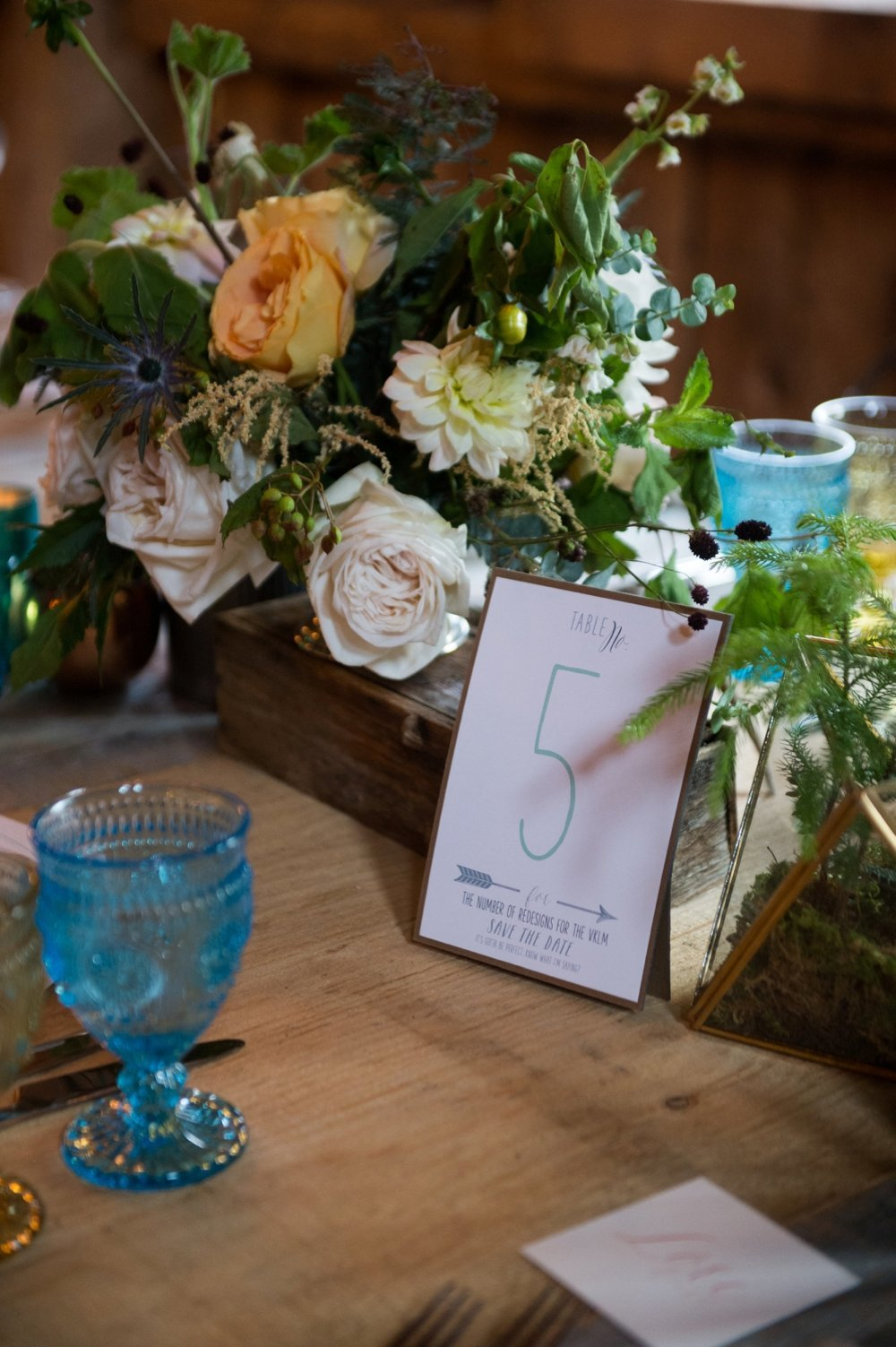 Rustic and unique table numbers for wedding at THe Barn on Walnut Hill