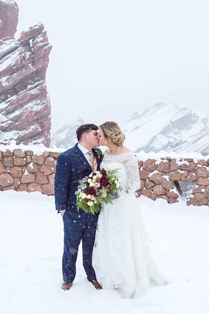 Couple in the snow at Red Rocks Park in Morrison