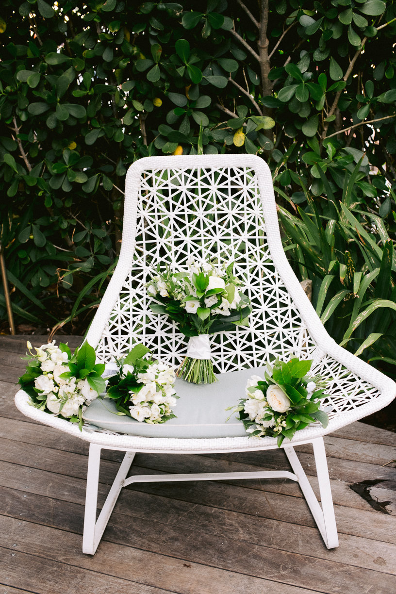bouquets in white chair
