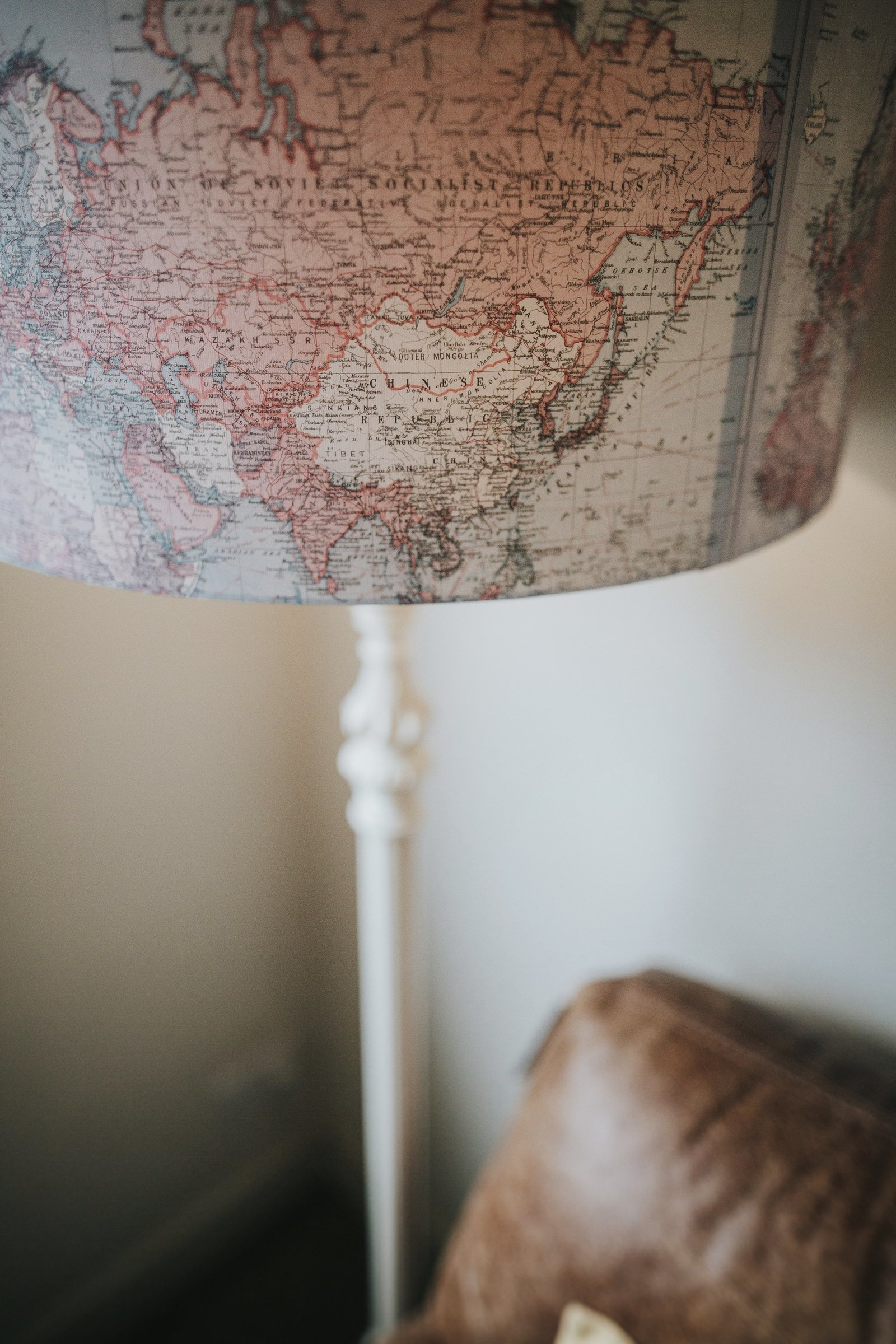 Map of the world lampshade in the lounge at Baldry's Lake District Cottage