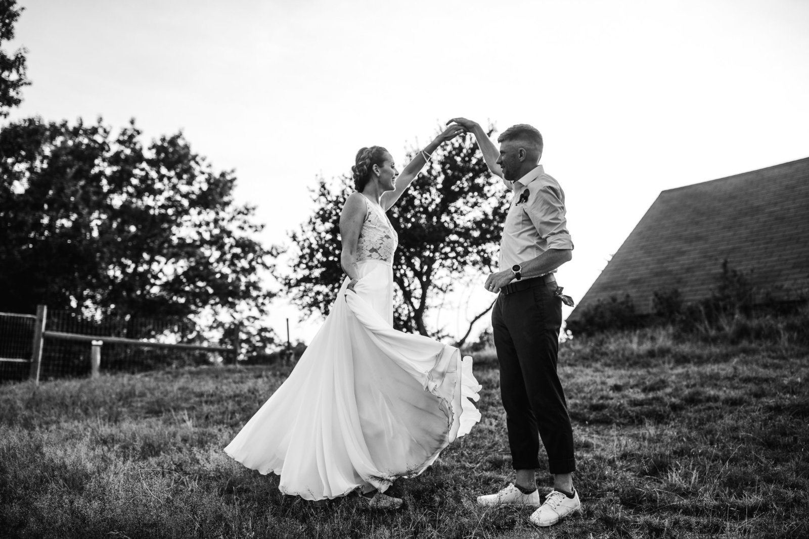 grooms spins bride outdoors on a farm in massachusetts