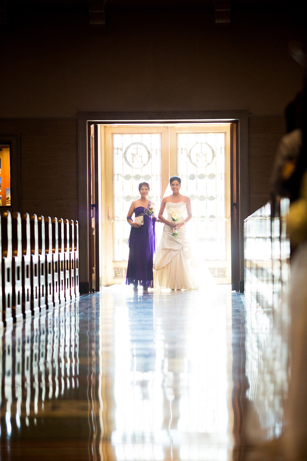 bride with mother  walking down the aisle at the immaculata