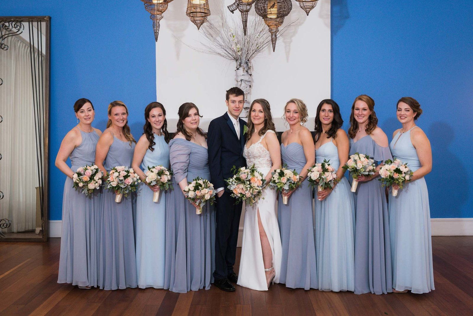 Bride and groom with bridesmaids at  Allegria Hotel