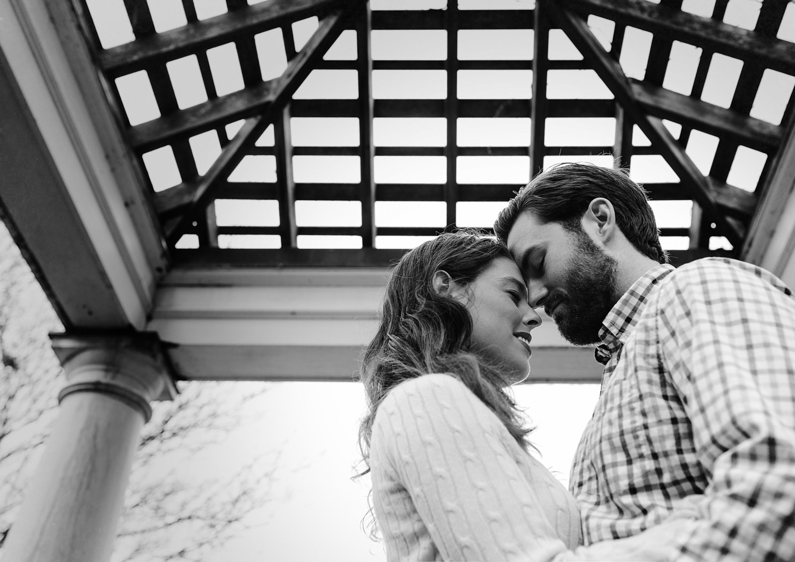Charlotte engagement photographer creates a beautiful black and white with an engaged couple under a gazebo