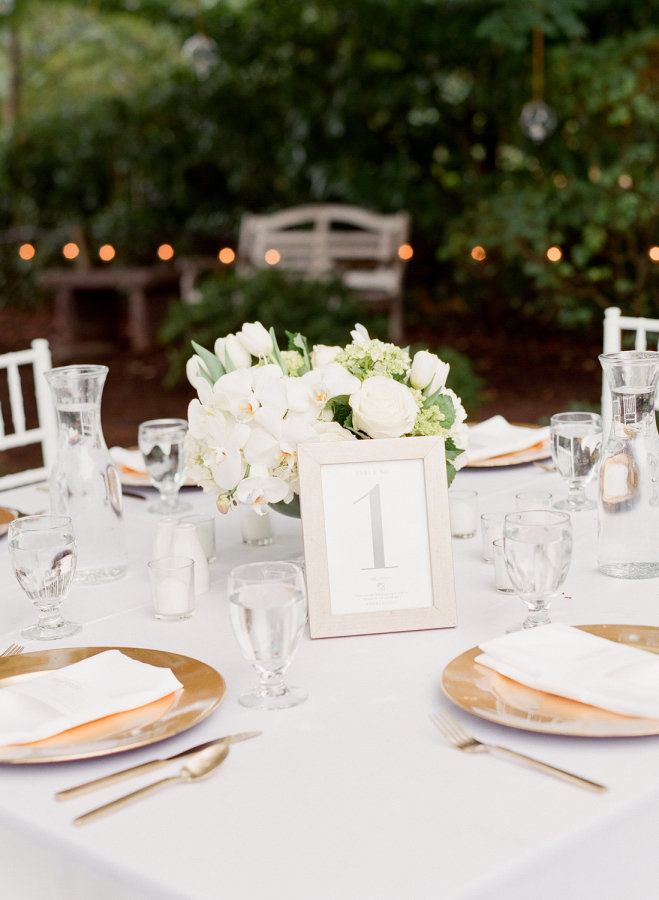 White orchids and roses wedding table arrangement