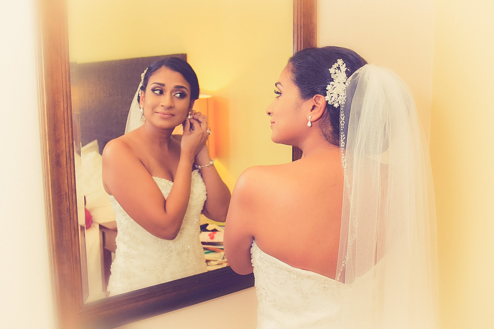 Bride with reflection in mirror. Photo by Ross Photography, Trinidad, W.I..