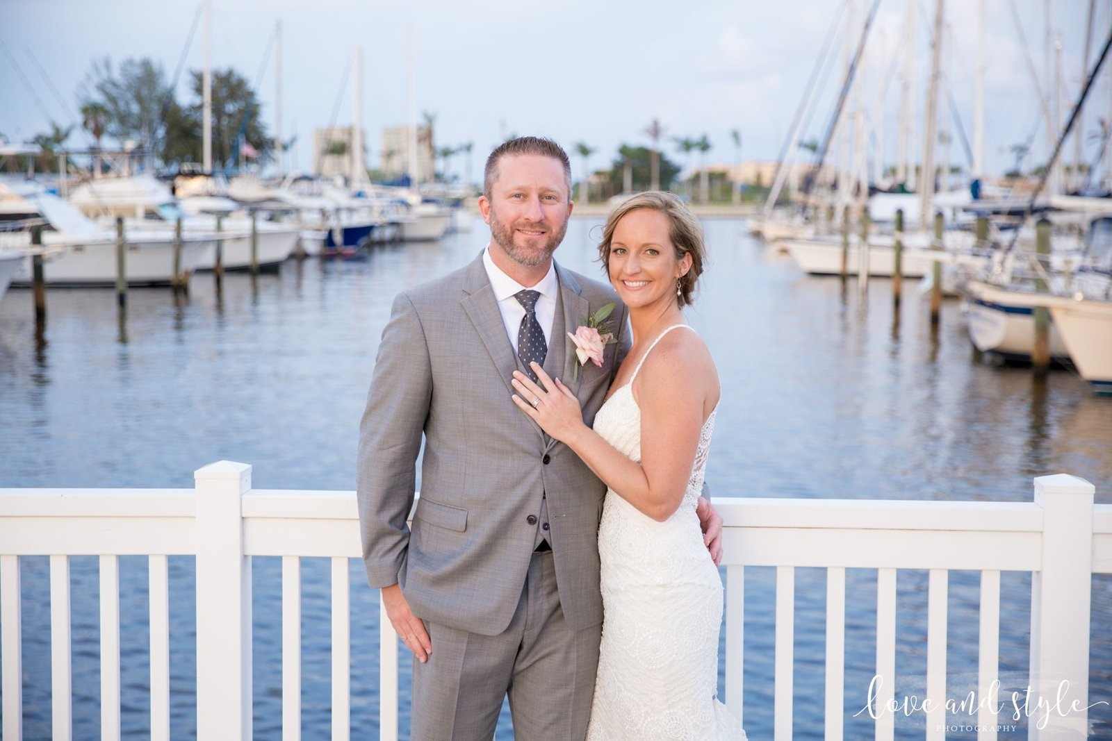 The Riverhouse Reef and Grill Wedding Photography bride and groom portrait on the dock
