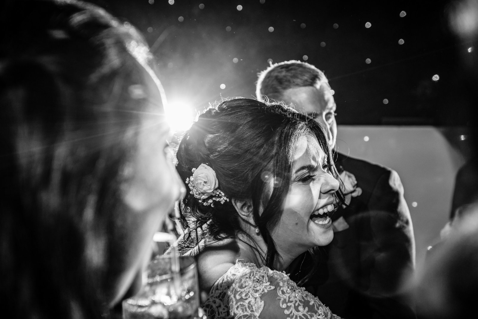 Bride cries happy tears on dancefloor.