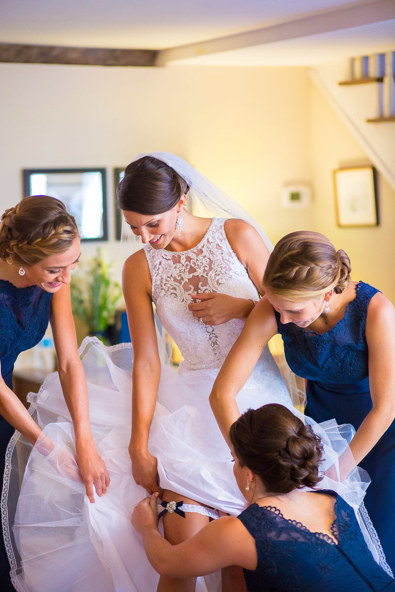 A photo of a bride getting ready for a usna naval academy chapel wedding