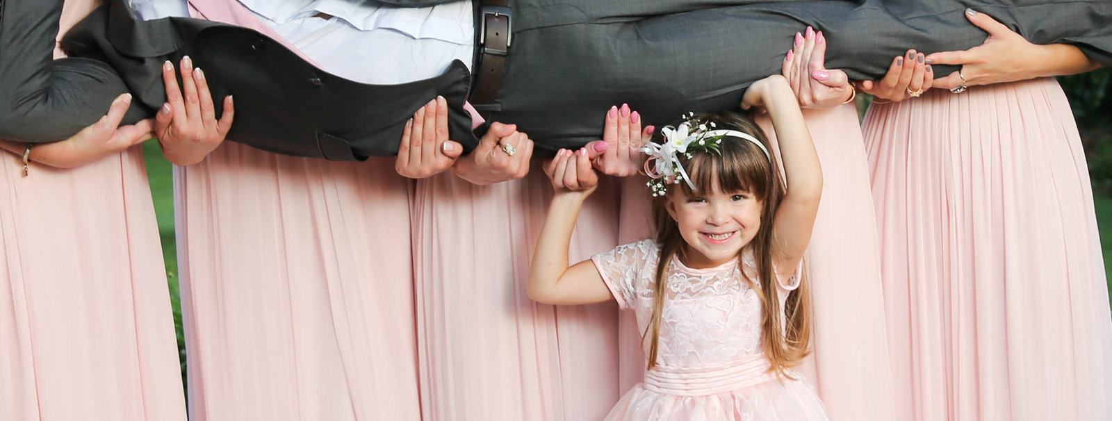 Flower girl fun shot with bridal party. Photo by Ross Photography, Trinidad, W.I..