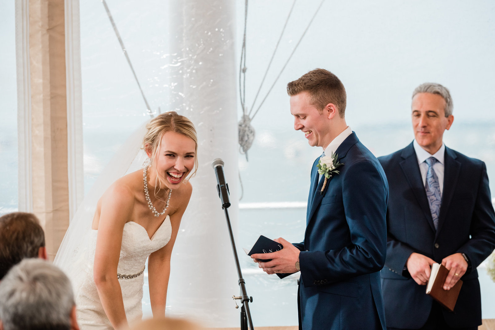 A couple reads their vows during their ceremony at a Duxbury Bay Maritime School wedding