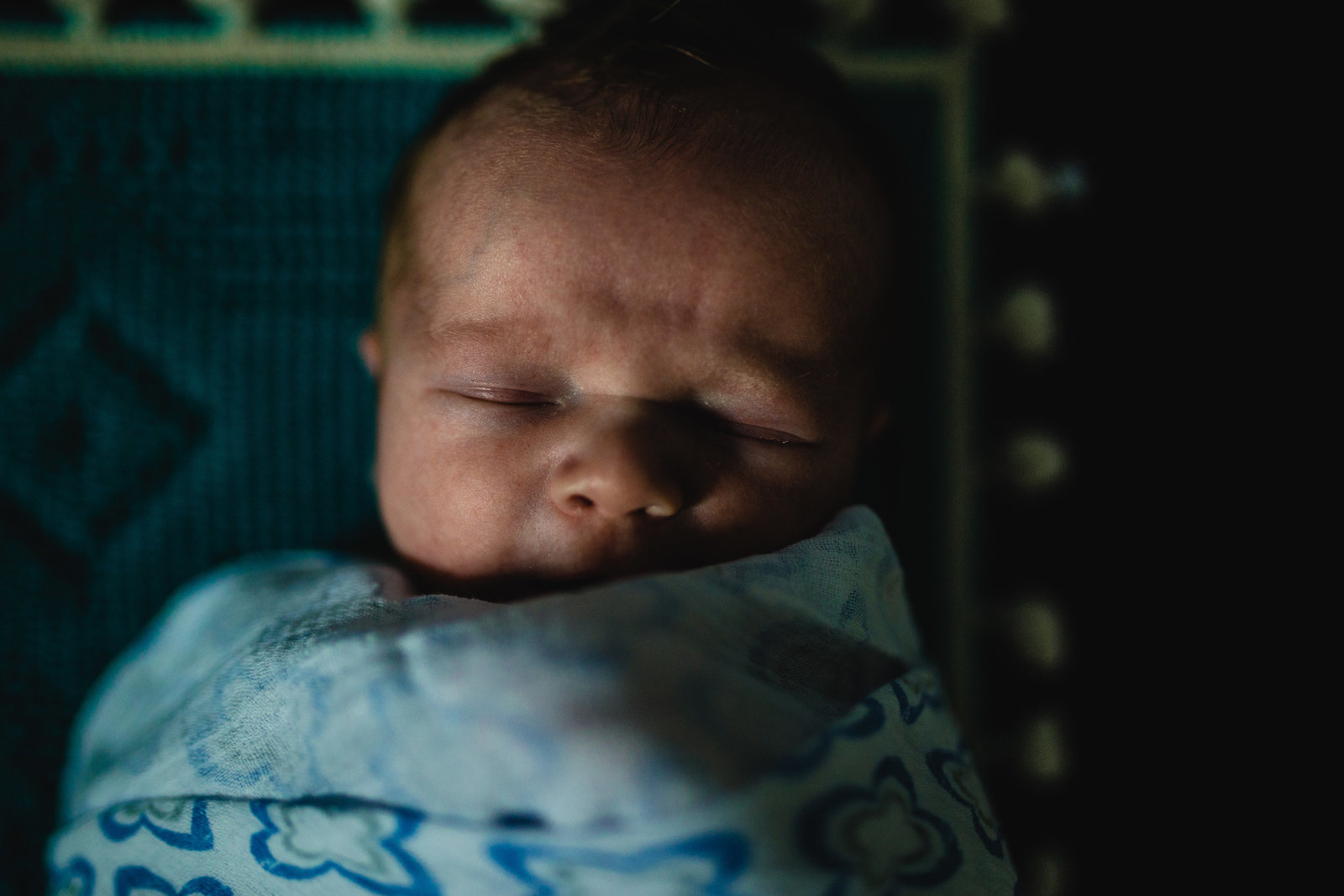 Portrait of newborn baby sleeping with blue blanket