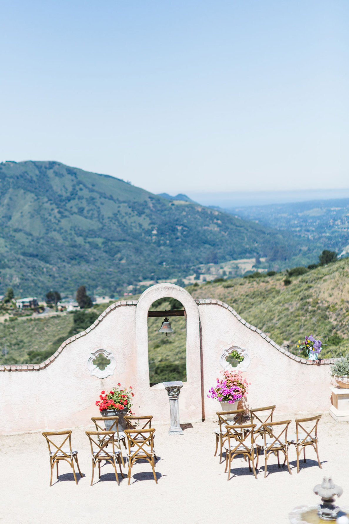 elegant outdoor wedding set up in the front driveway of chateau carmel overlooking carmel valley