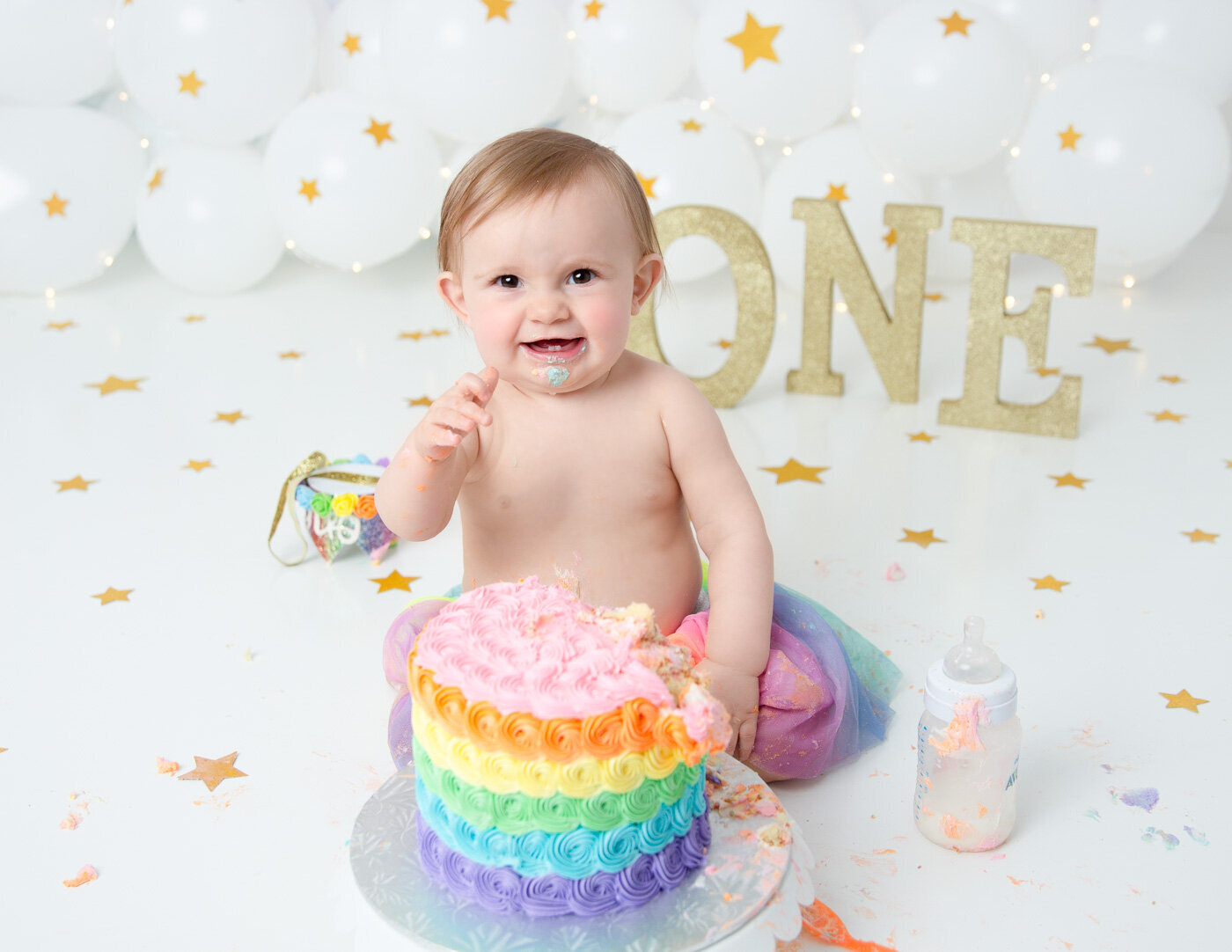 Rainbow cake smash at our  studio in Rochester, NY.