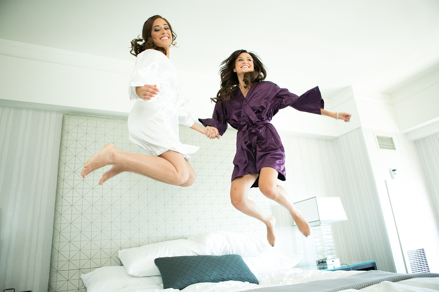 Bride jumping on the bed before she is wed
