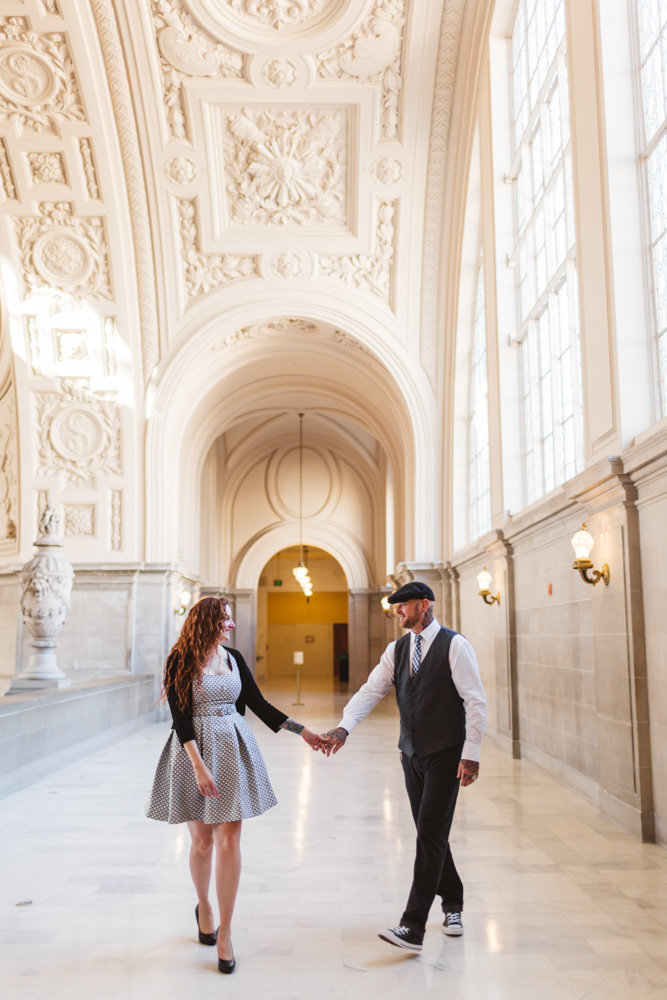rad tattooed couple walking on 4th floor of san francisco city hall