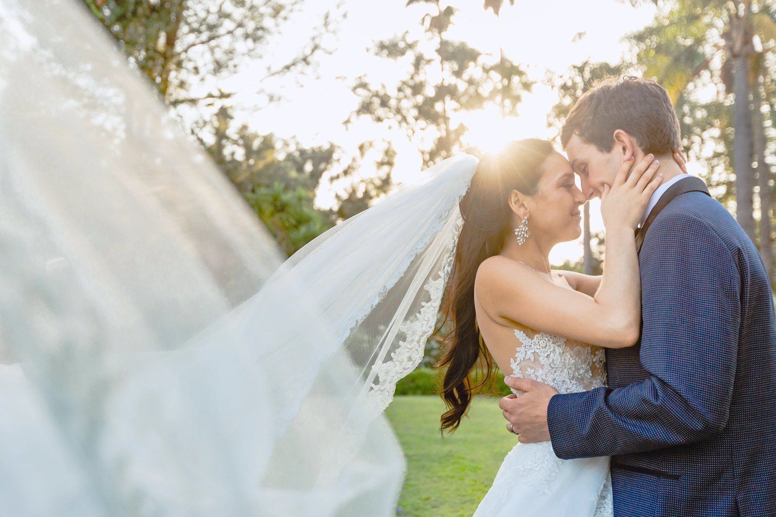 bride and groom embrace for their couple photos at newhall mansion