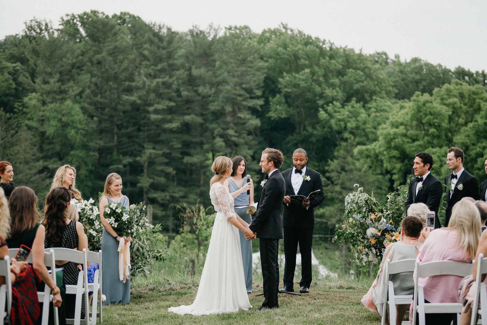Bride and groom pictured together at their wedding ceremony in the countryside.