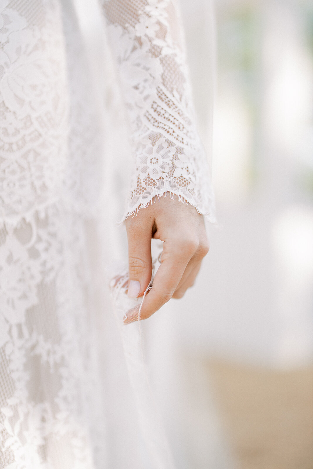 Romantic lace details of Claire Pettibone wedding dress