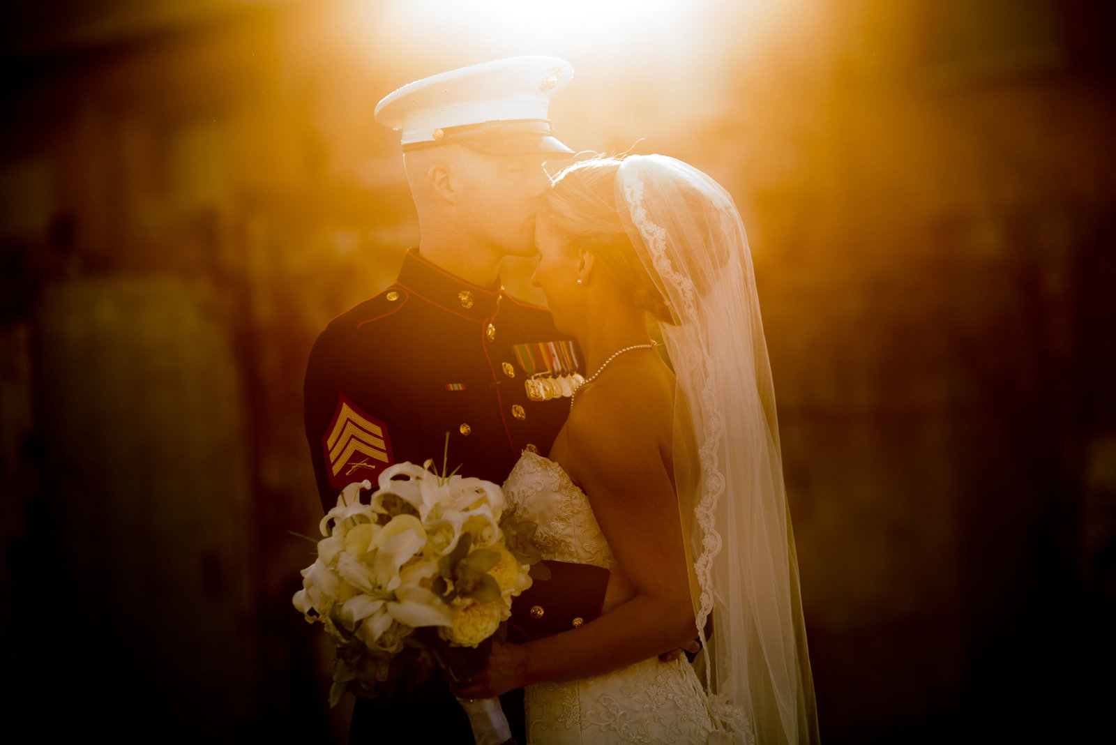 marine kissing bride