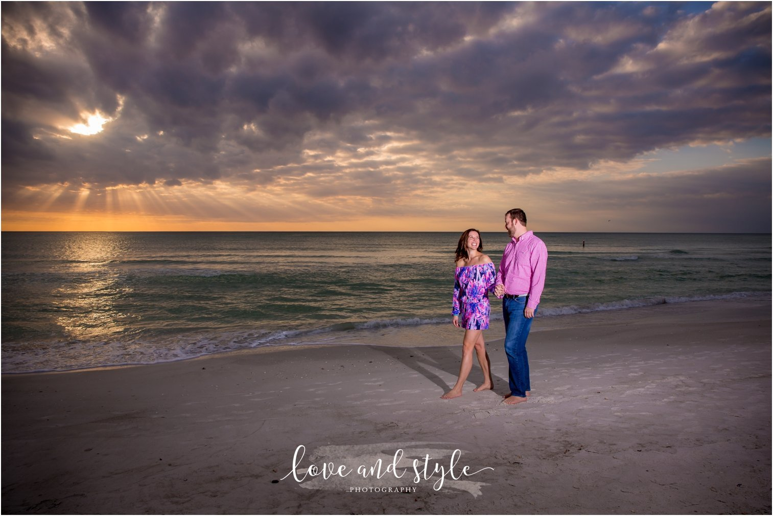Anna Maria Island Engagement Photography of couple holding hands and walking along the beach