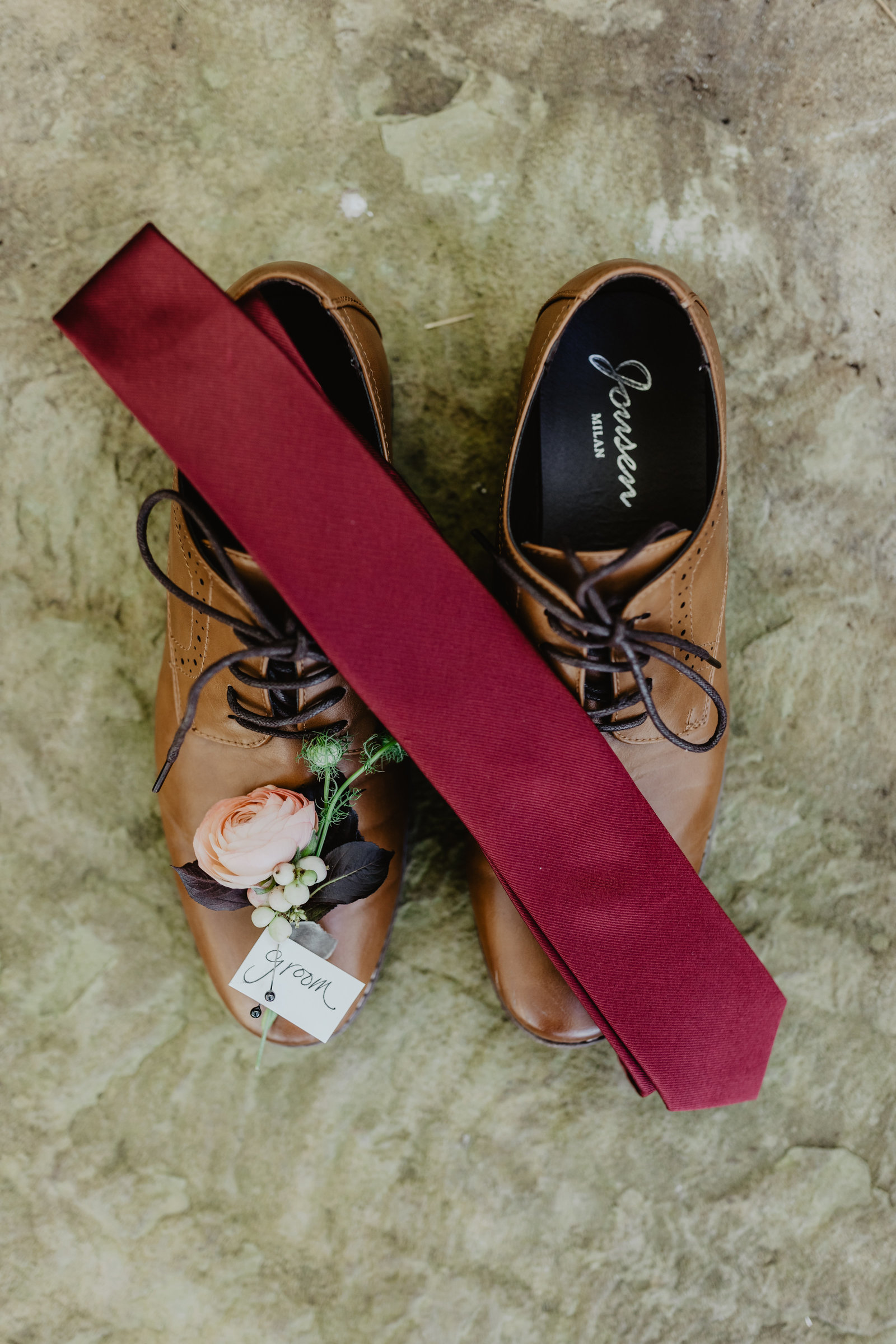 Groom details featuring delicate boutonnière for Arkansas wedding