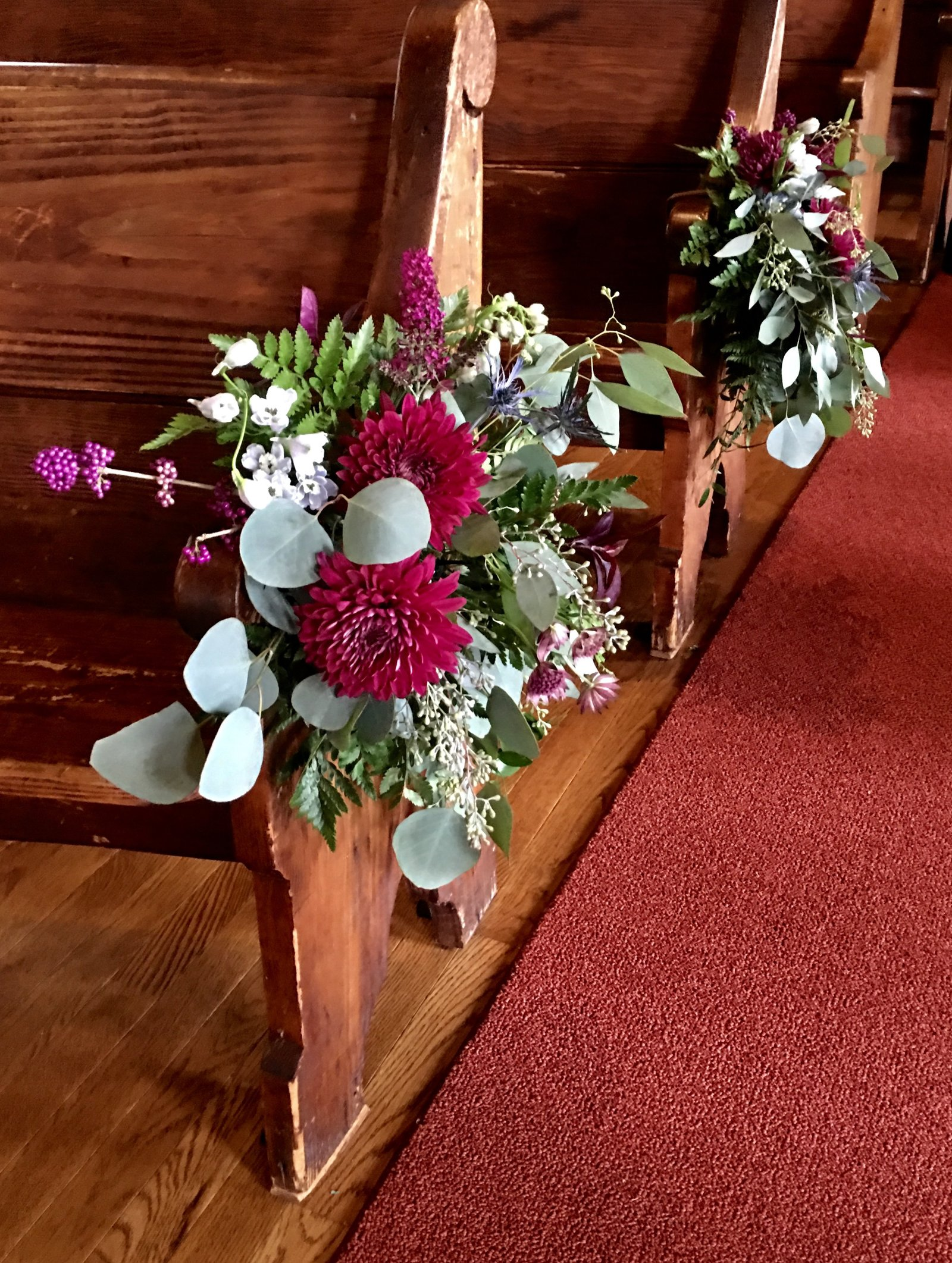 Rustic floral decor for church aisle pews