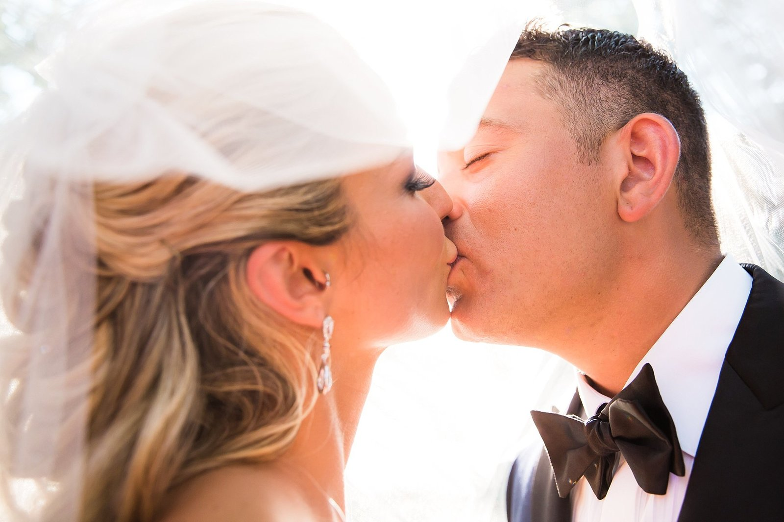 M Harris Studios_Trump National Golf Club Wedding_bride and groom kiss under veil