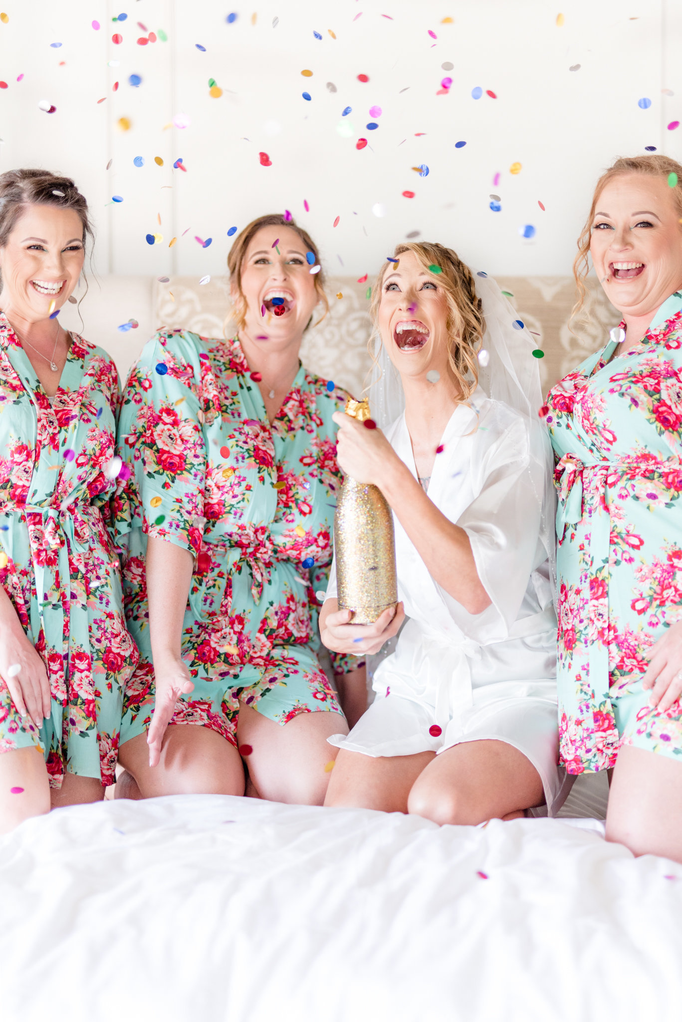 Tampa Bride and Bridesmaids pop confetti.