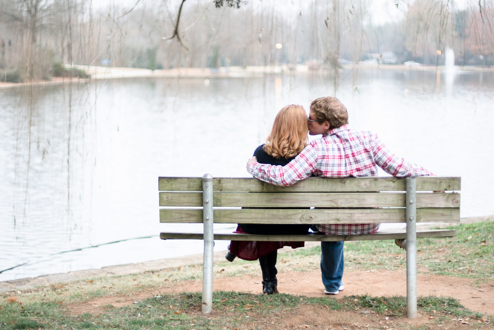 Charlotte family photographer shot of couple on bench in freedom park