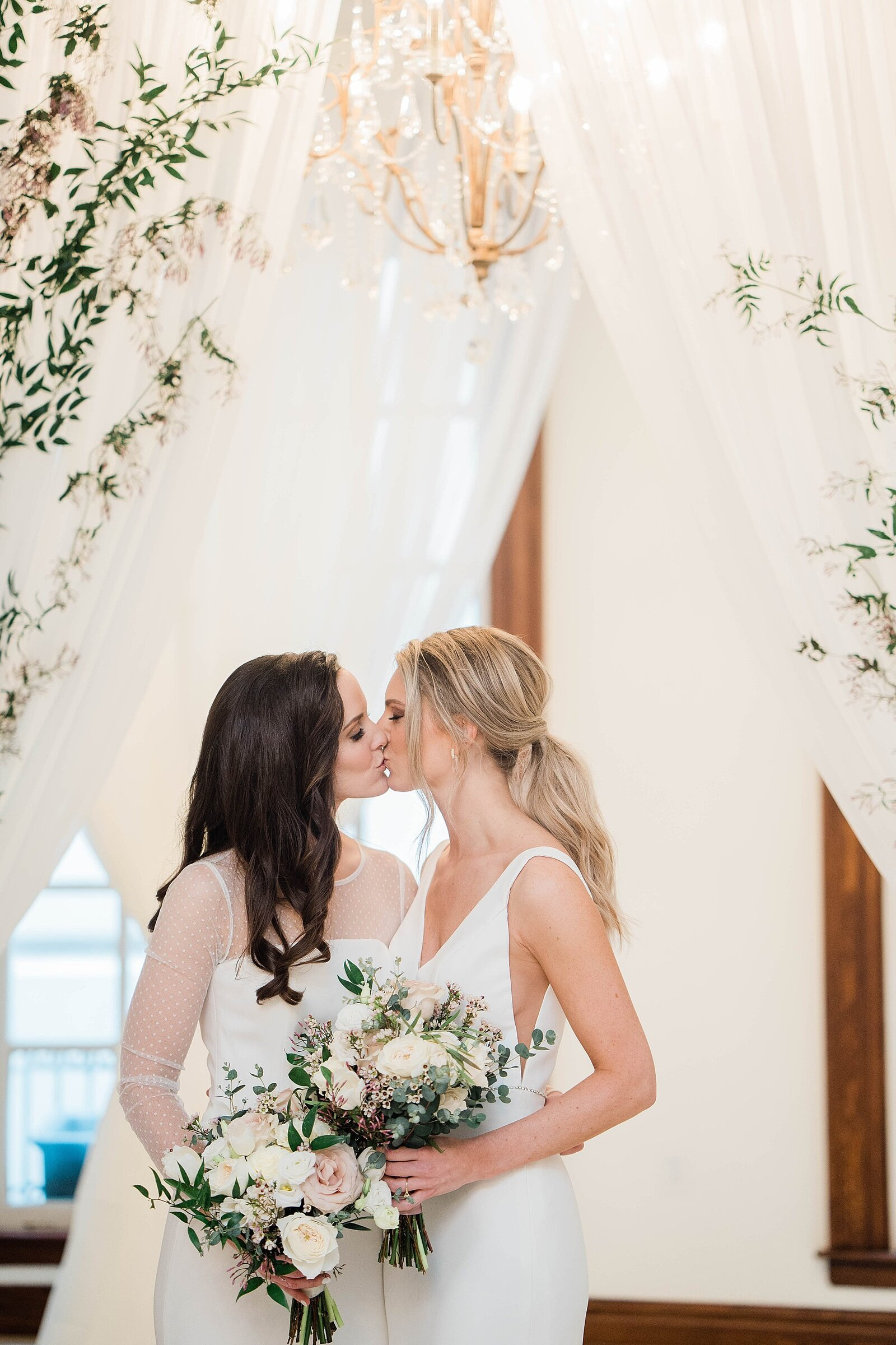 LGBTQ couple kisses at Kansas City Club wedding