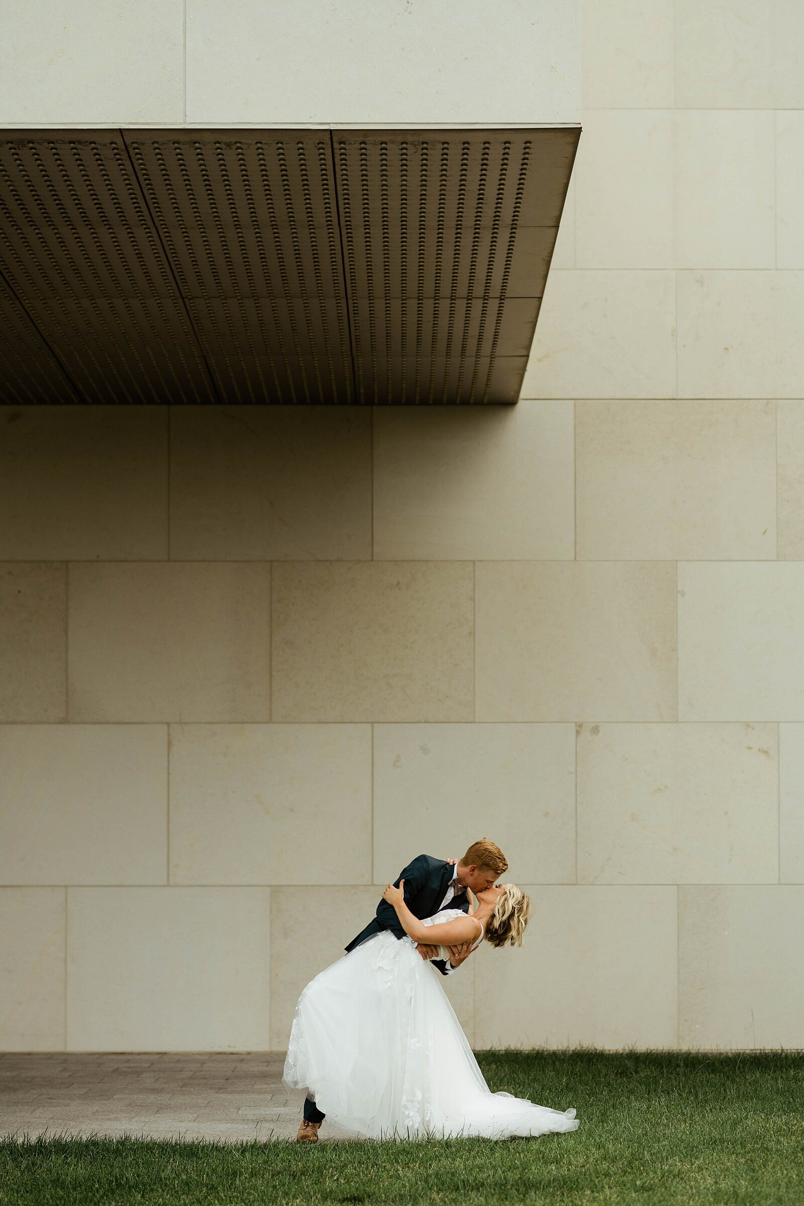 Groom dips bride for kiss at Nerman Museum