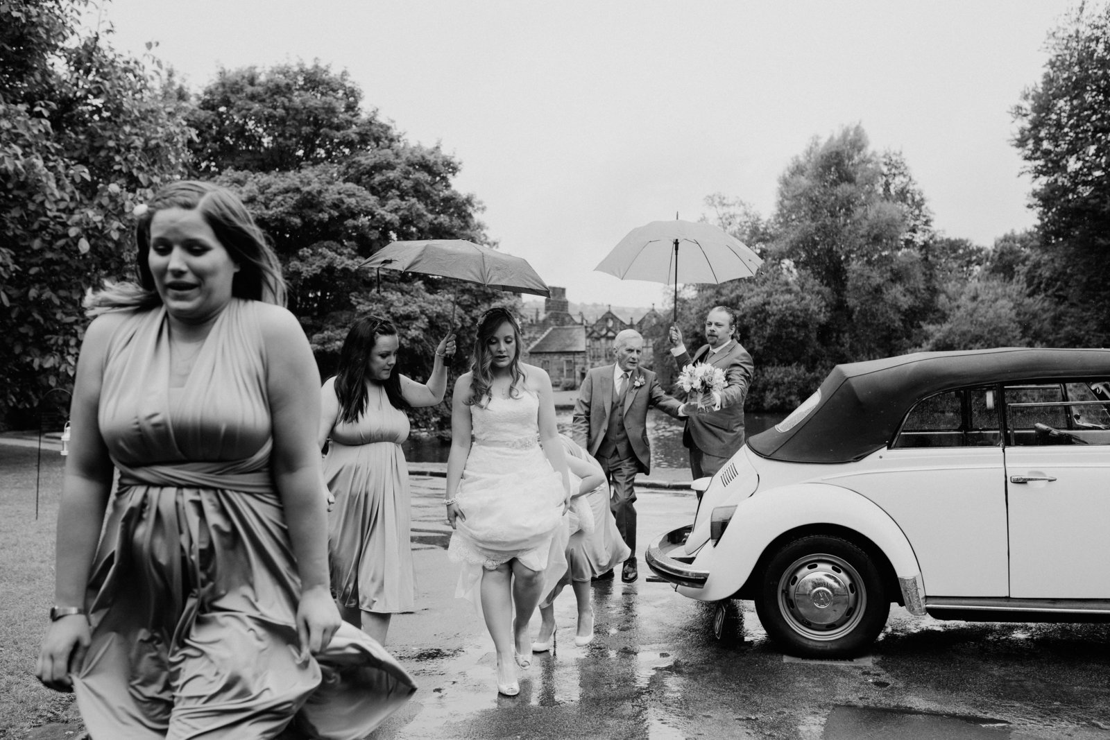Bridal party in rain at Airedale Barn, East Riddlesden Hall, Yorkshire wedding photographer