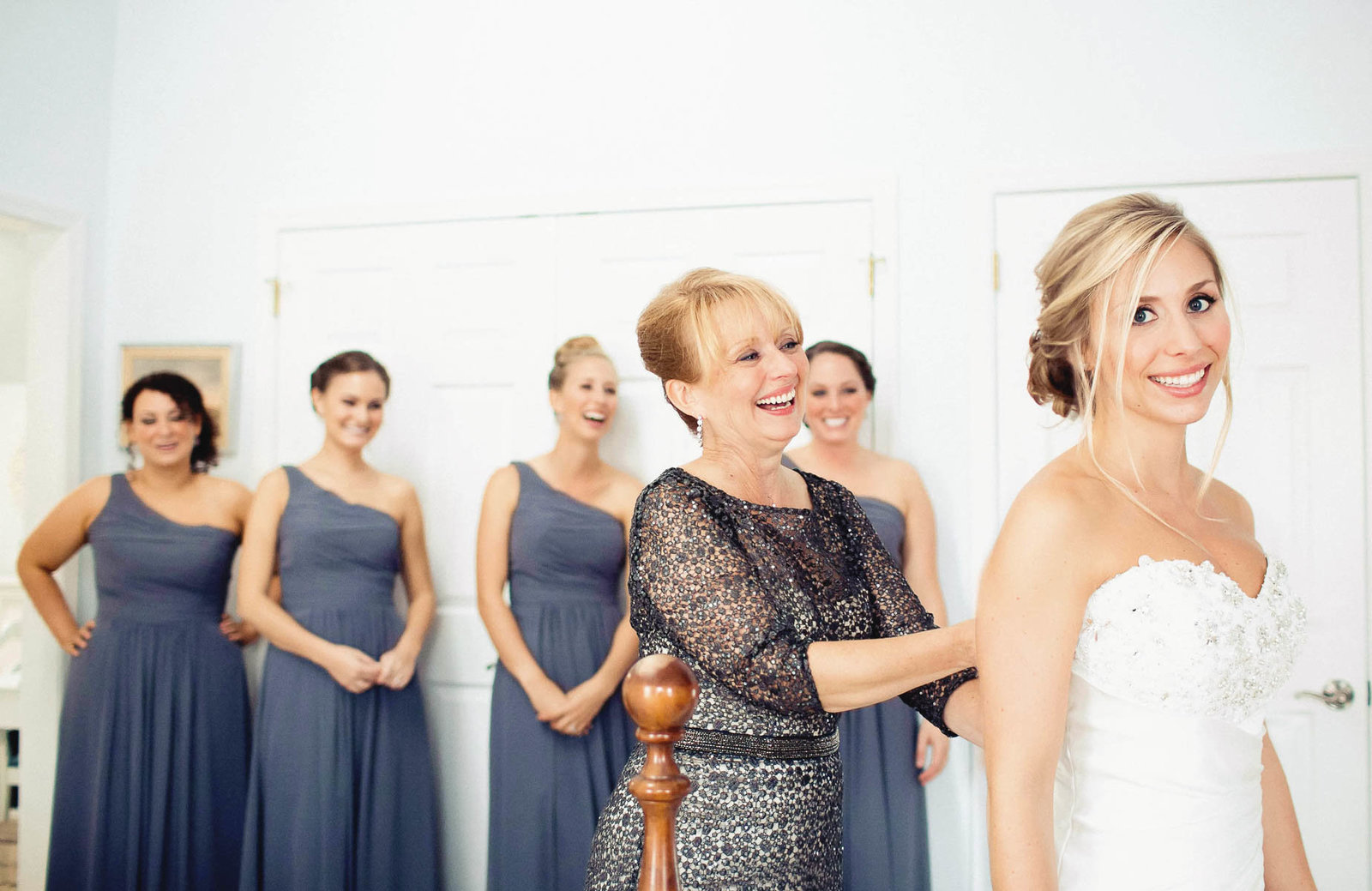 Bride gets into dress, Greenville Country Club, Delaware. Kate Timbers Photography.