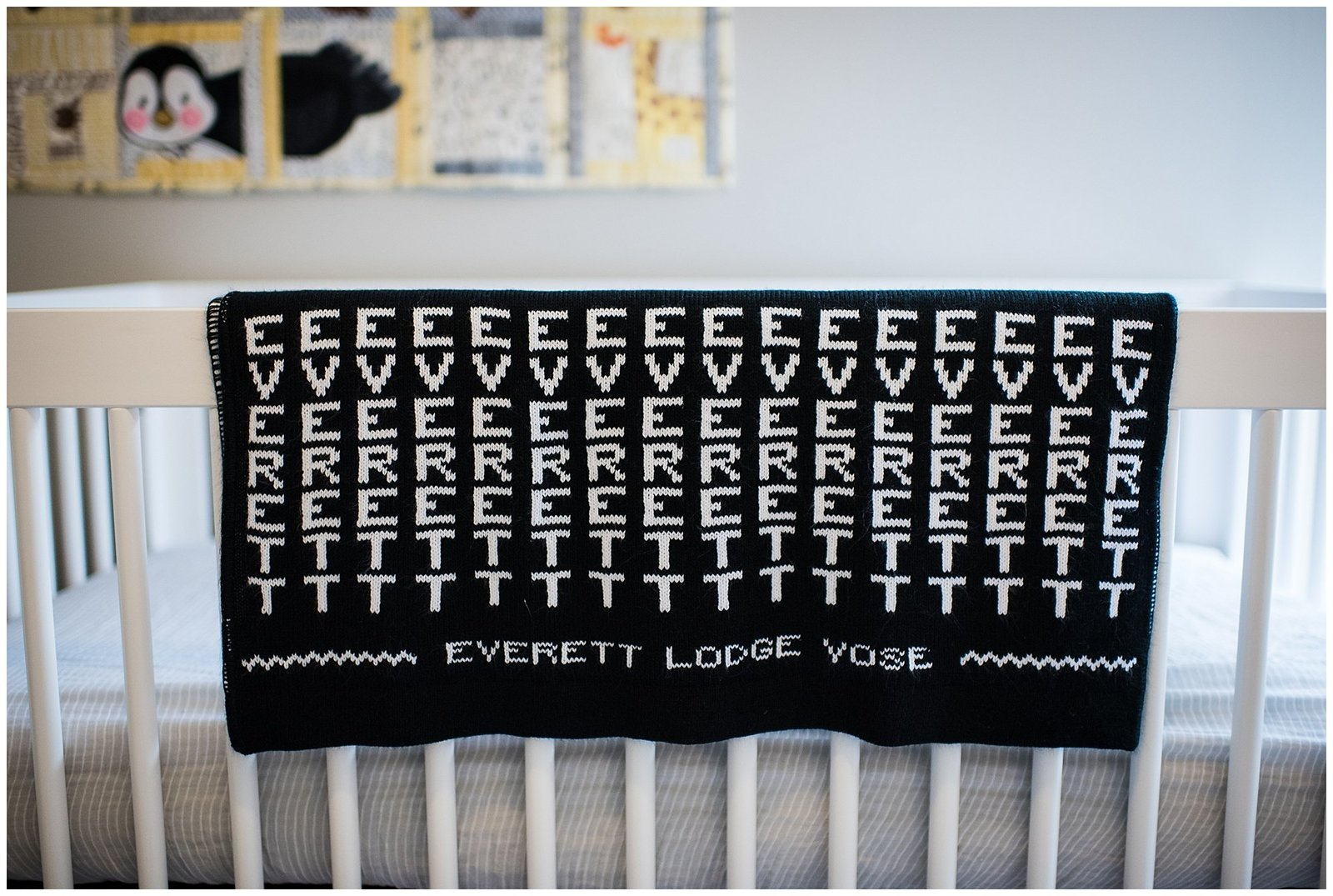 baby Everett name quilt on crib nursery in home lifestyle newborn photoshoot Emily Ann Photography Seattle Photographer