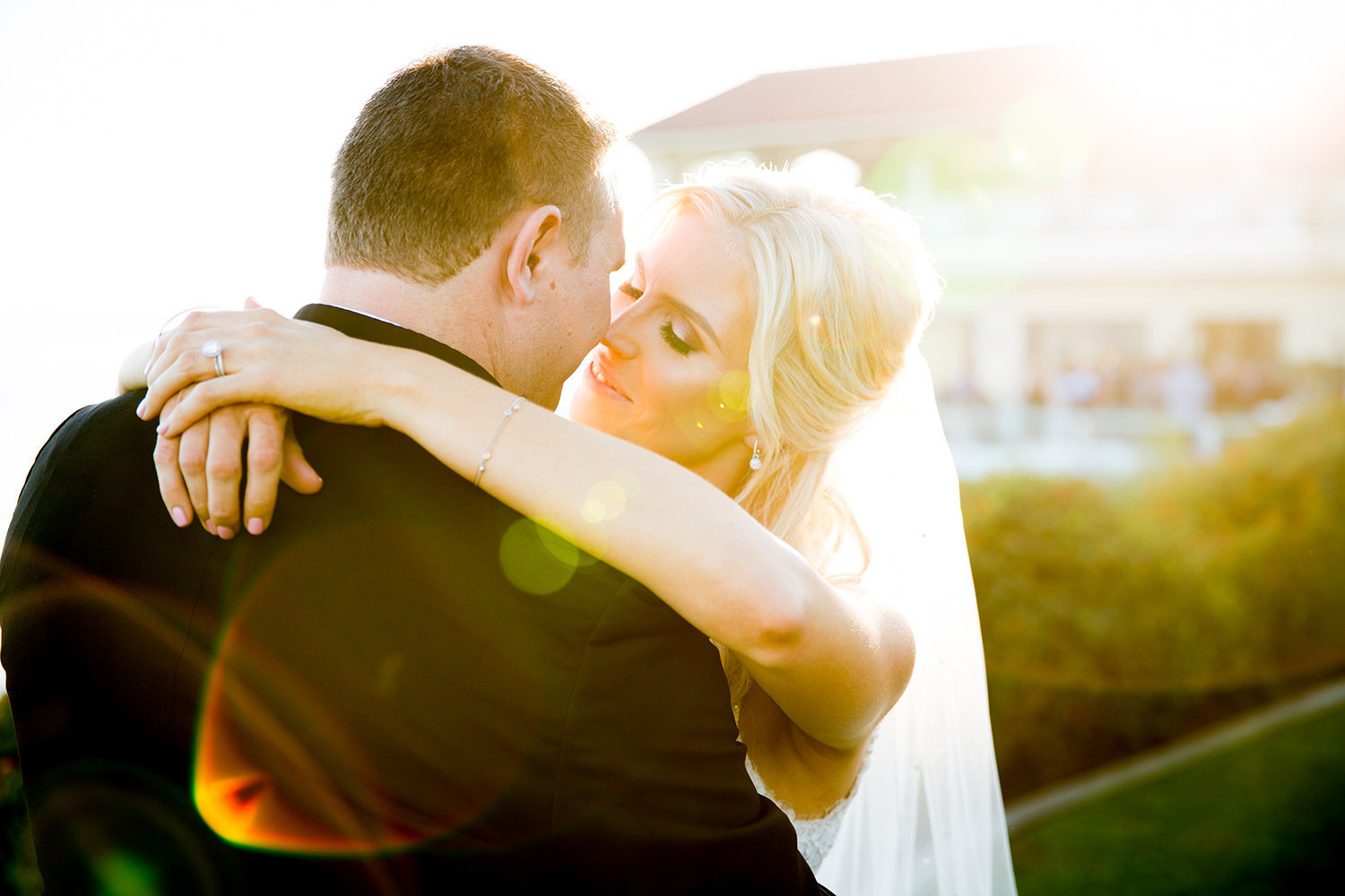 bride and groom with lens flare