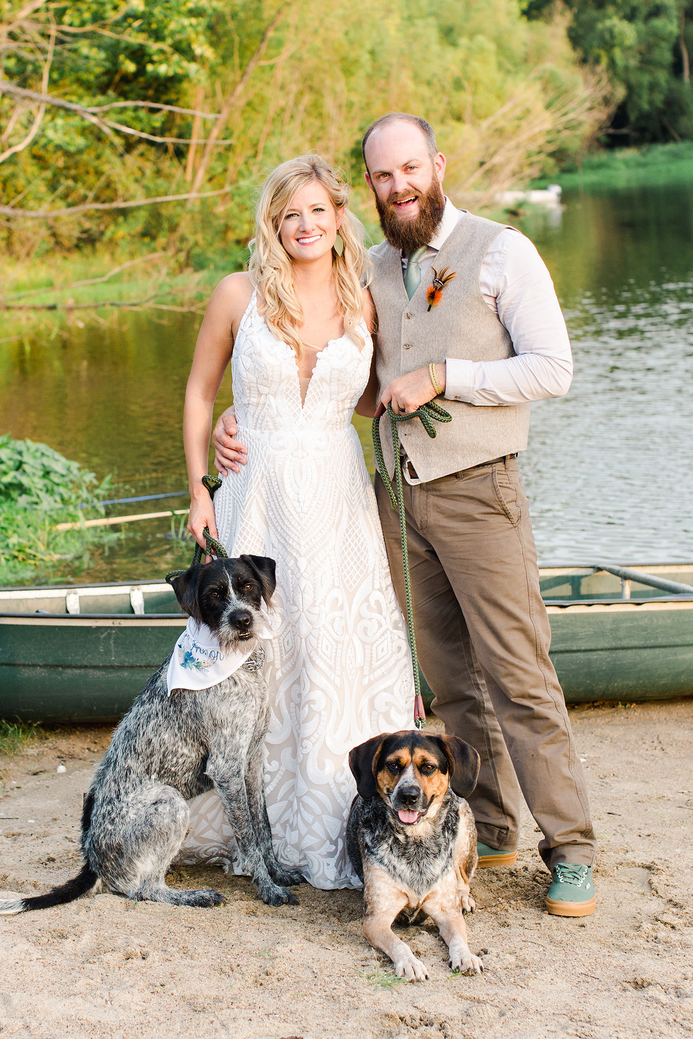Newly married couple and their dogs at Little Piney Lodge Wedding