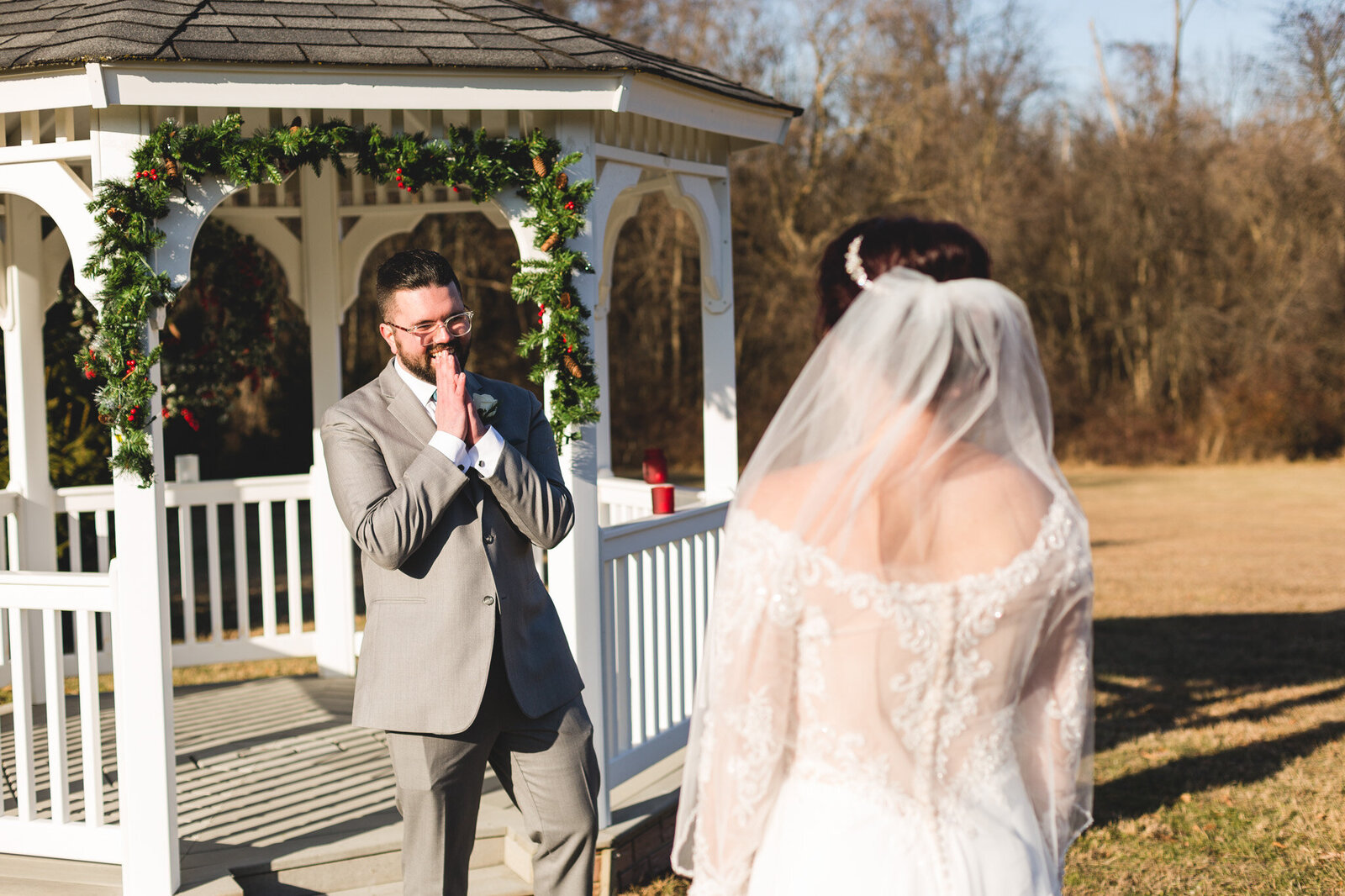 groom reacting to first look winter wedding ohio