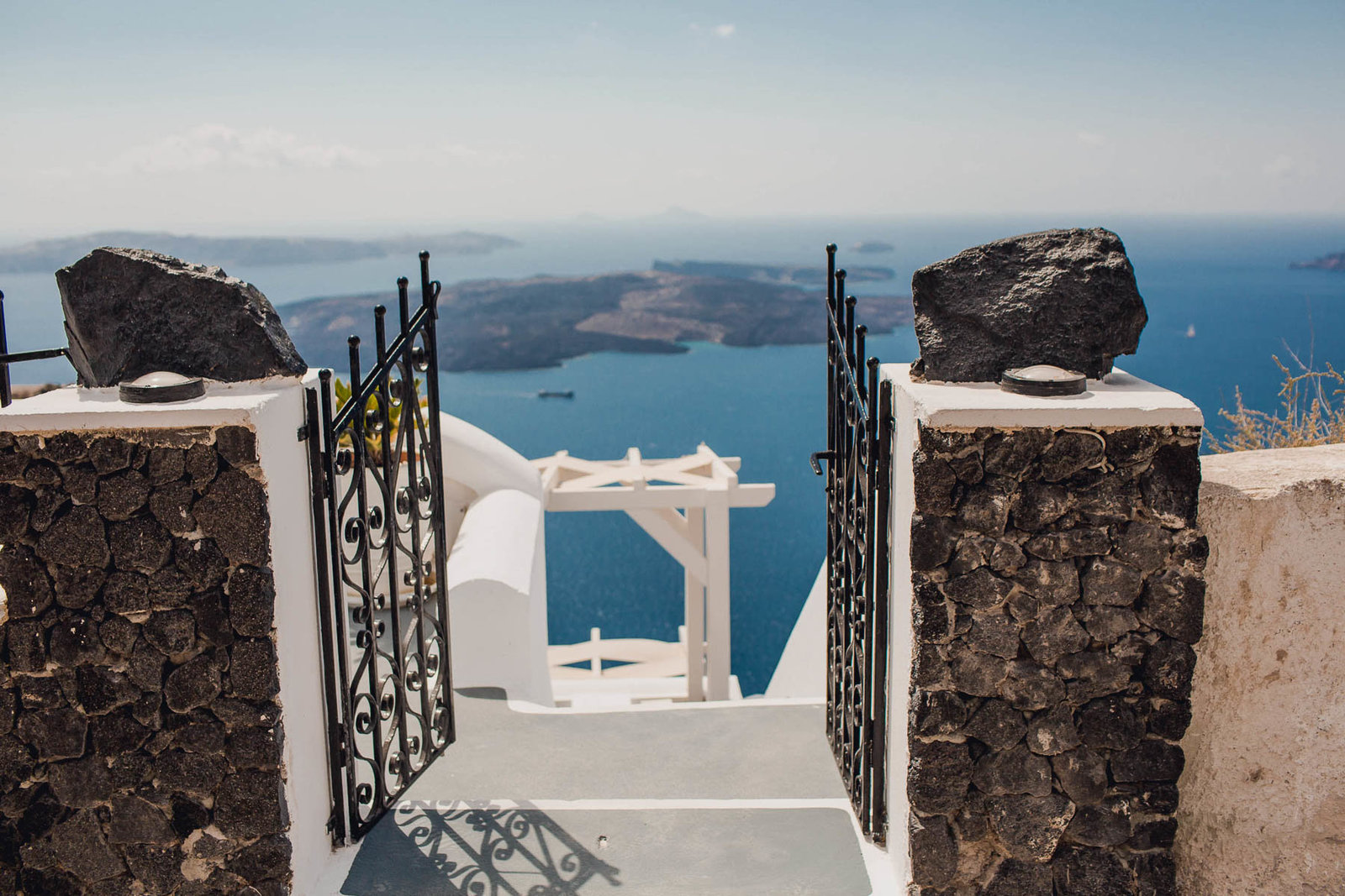 Iron gates leading to a view of the blue ocean, Santorini Island, Greece