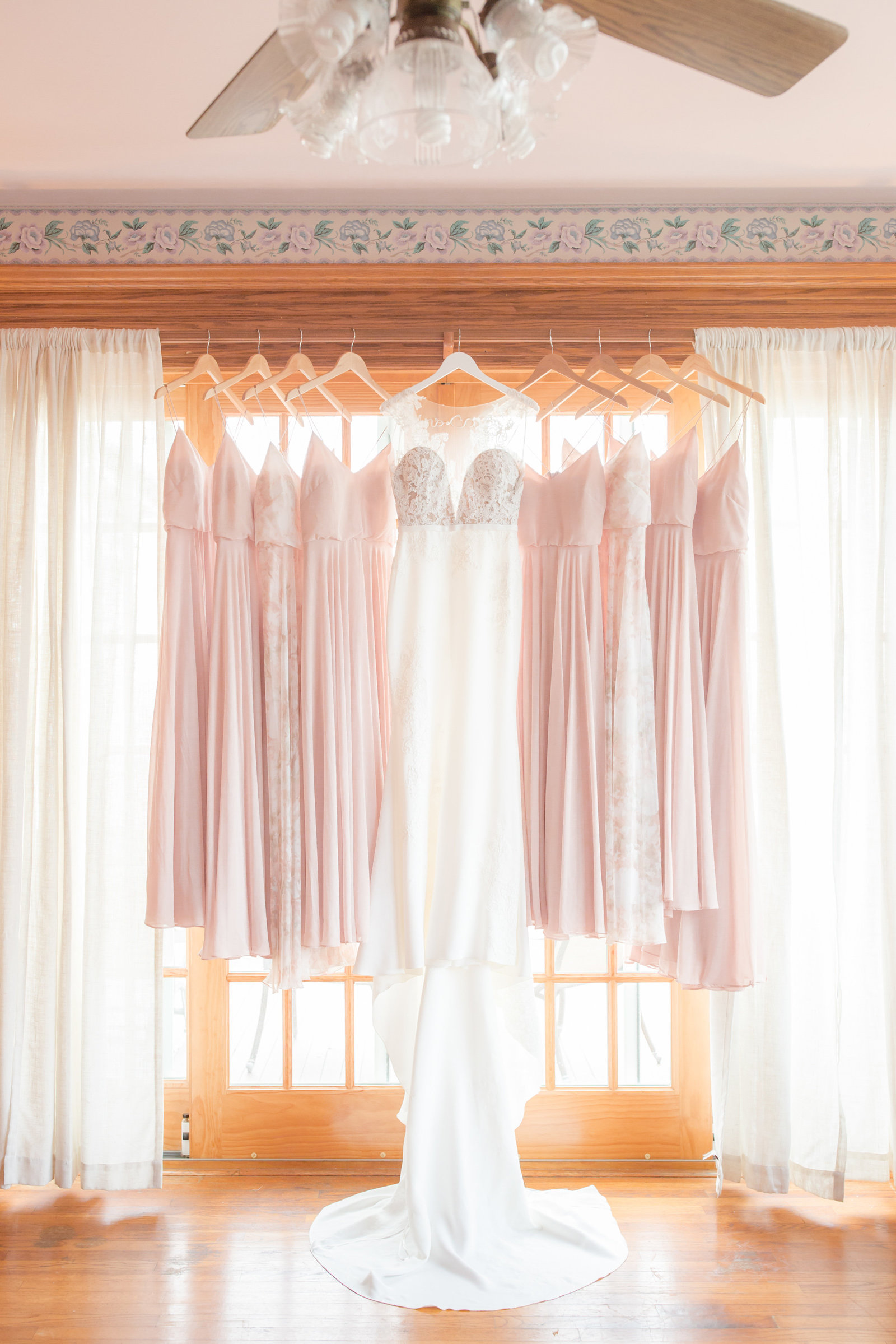 Bride's gown and pink bridesmaid dresses