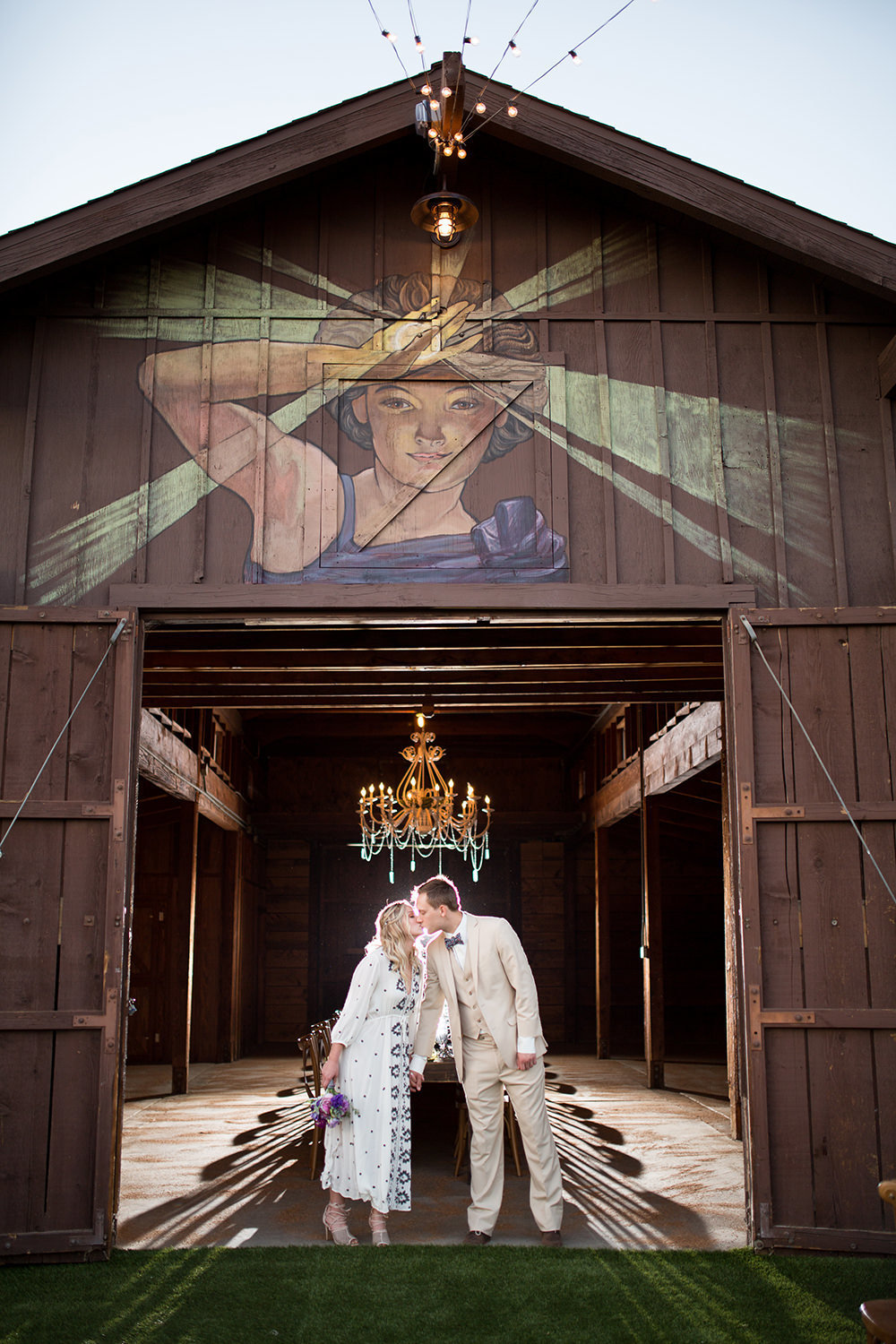 rustic barn with bride and groom