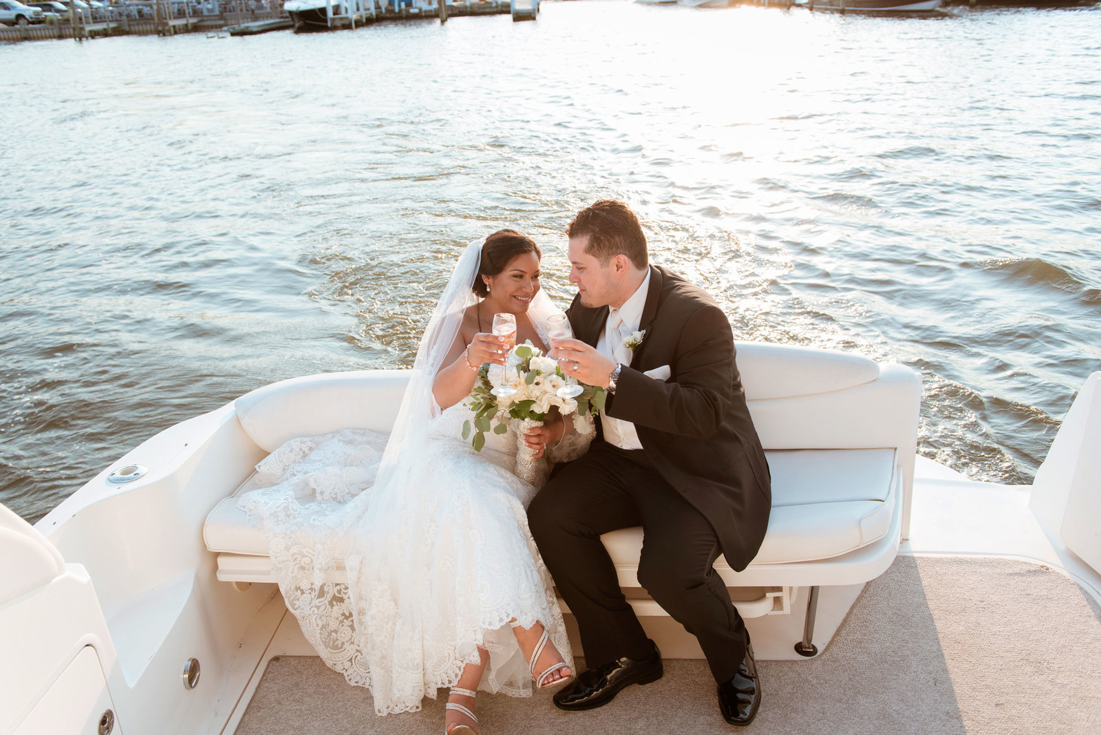 Bride and groom sitting on a boat at Chateau La Mer