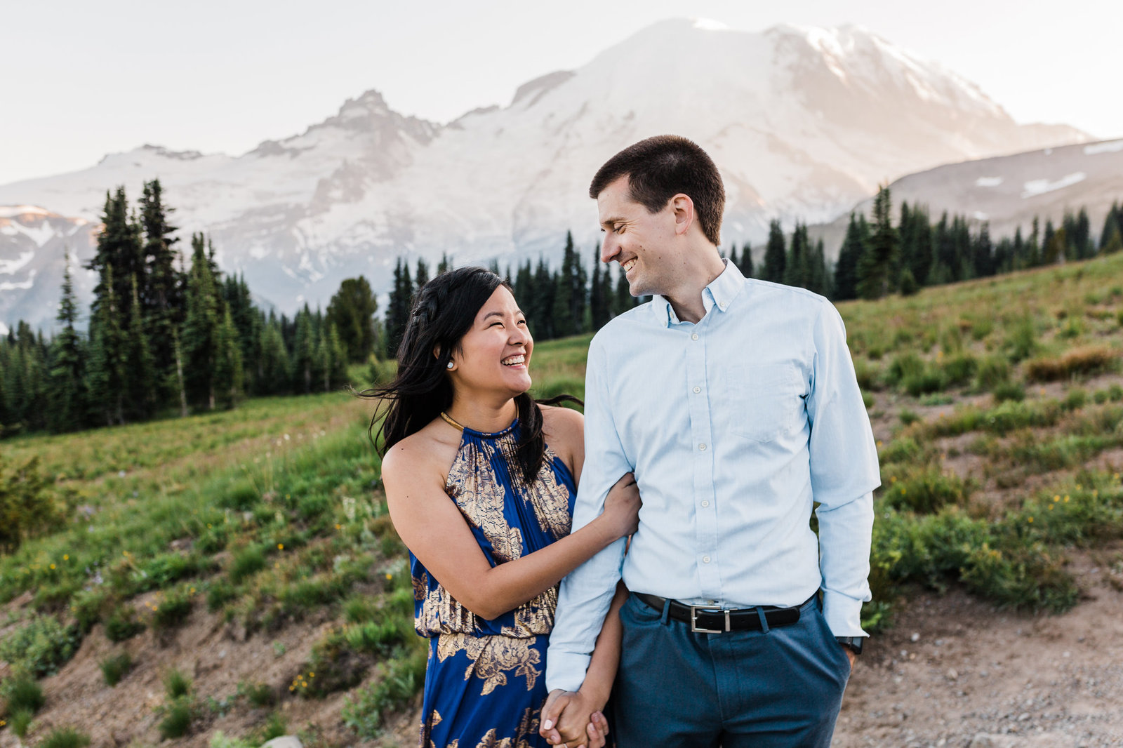 A couple strolls together through Mt Rainier National Park during their adventure session with outdoor elopement photographer amy galbraith