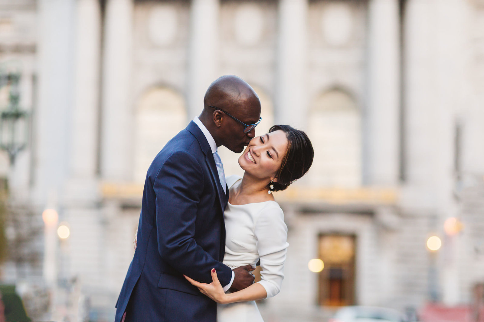 couple celebrating their wedding in portrait session at the back of san francisco city hall
