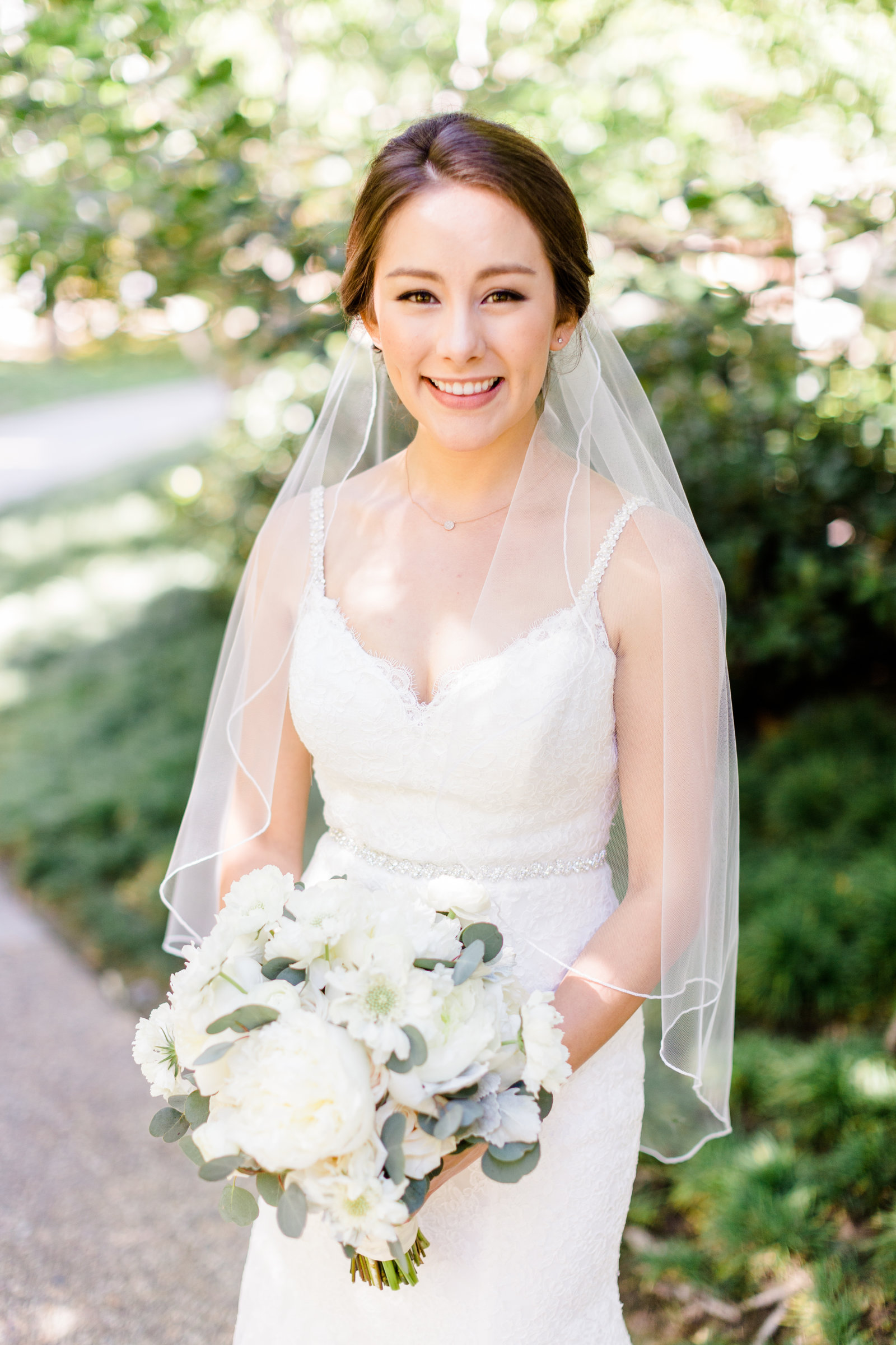 Bridal portrait with white peony bouquet