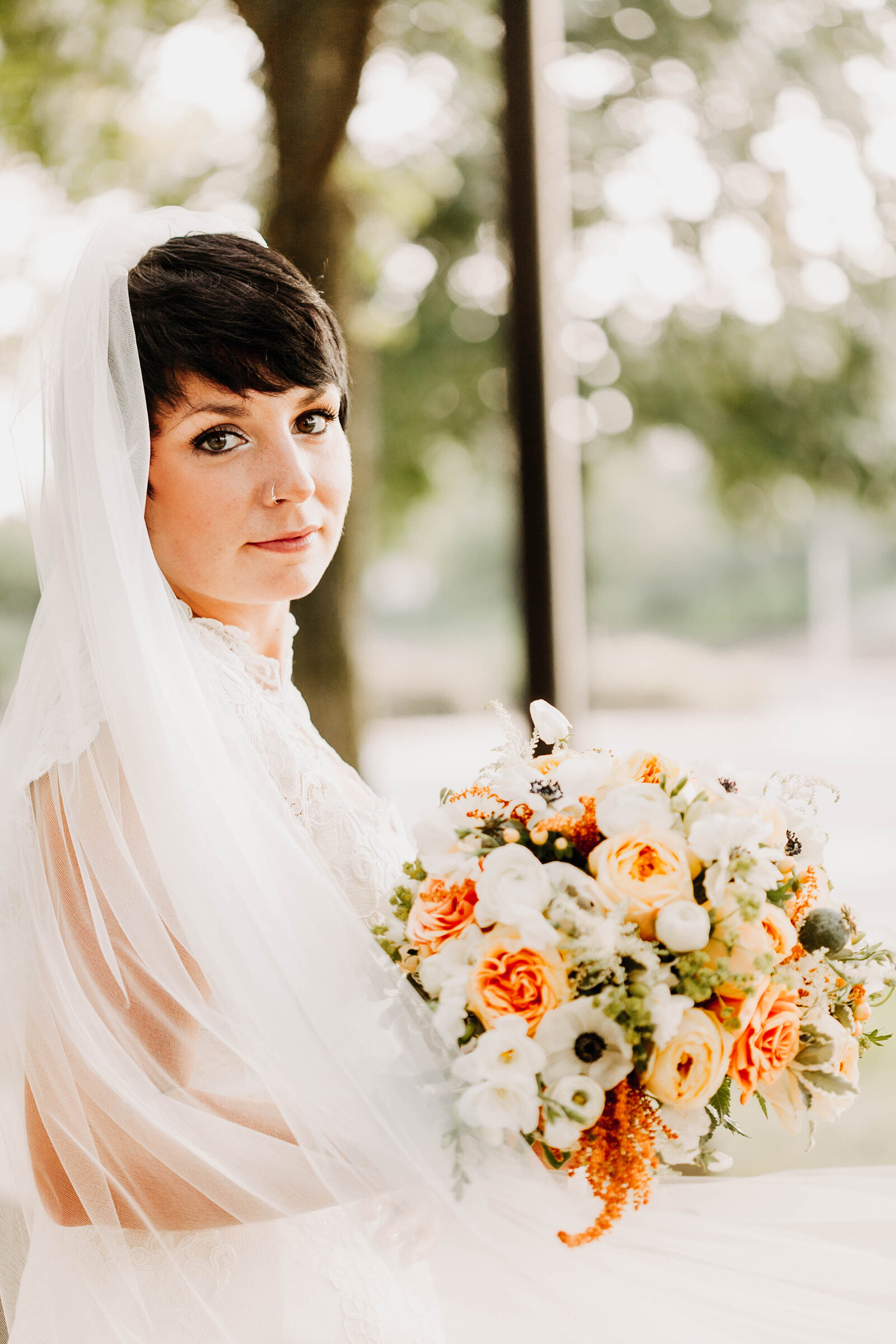 bride long veil orange flower bouquet