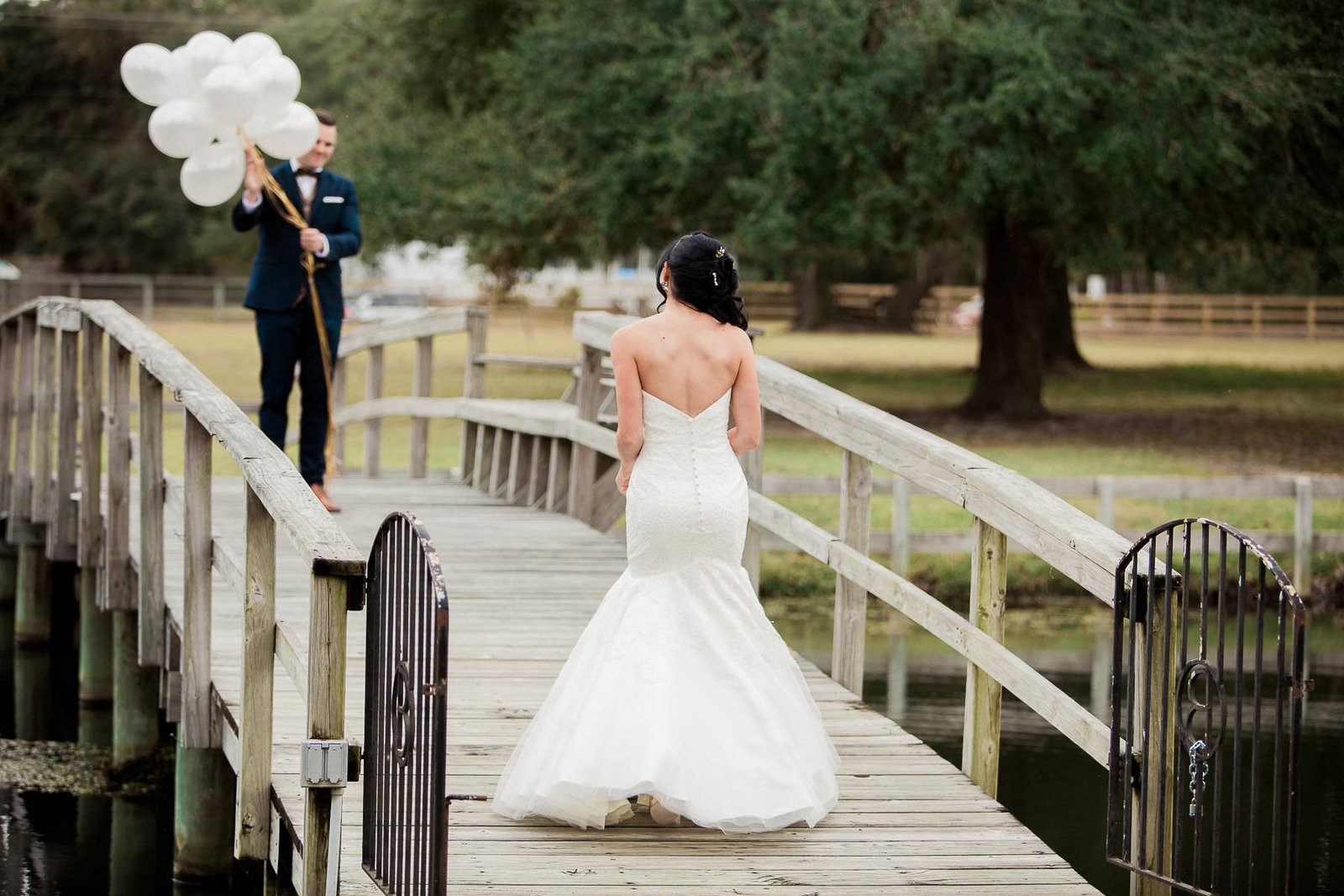 Bride and groom have first look on bridge, Boals Farm, Charleston, South Carolina