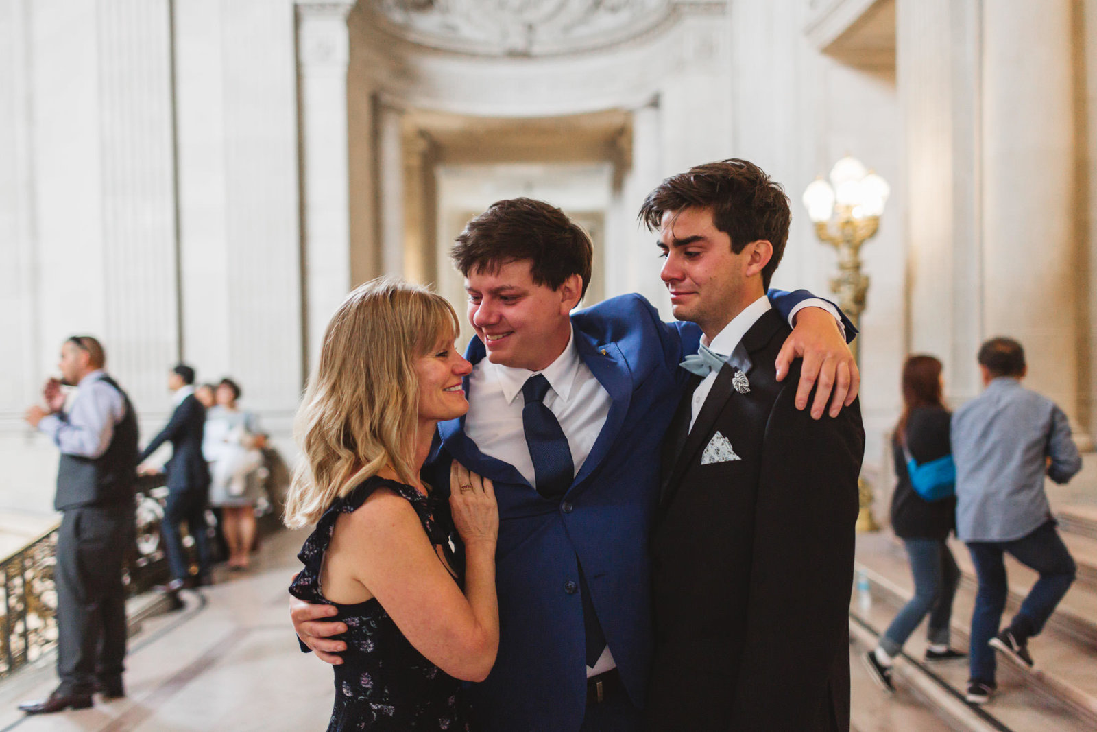 emotional family group crying prior to san francisco city hall wedding ceremony