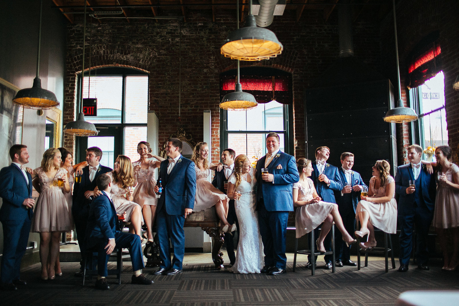 wedding party posing in chairs at venue St Louis Pinxit Photo