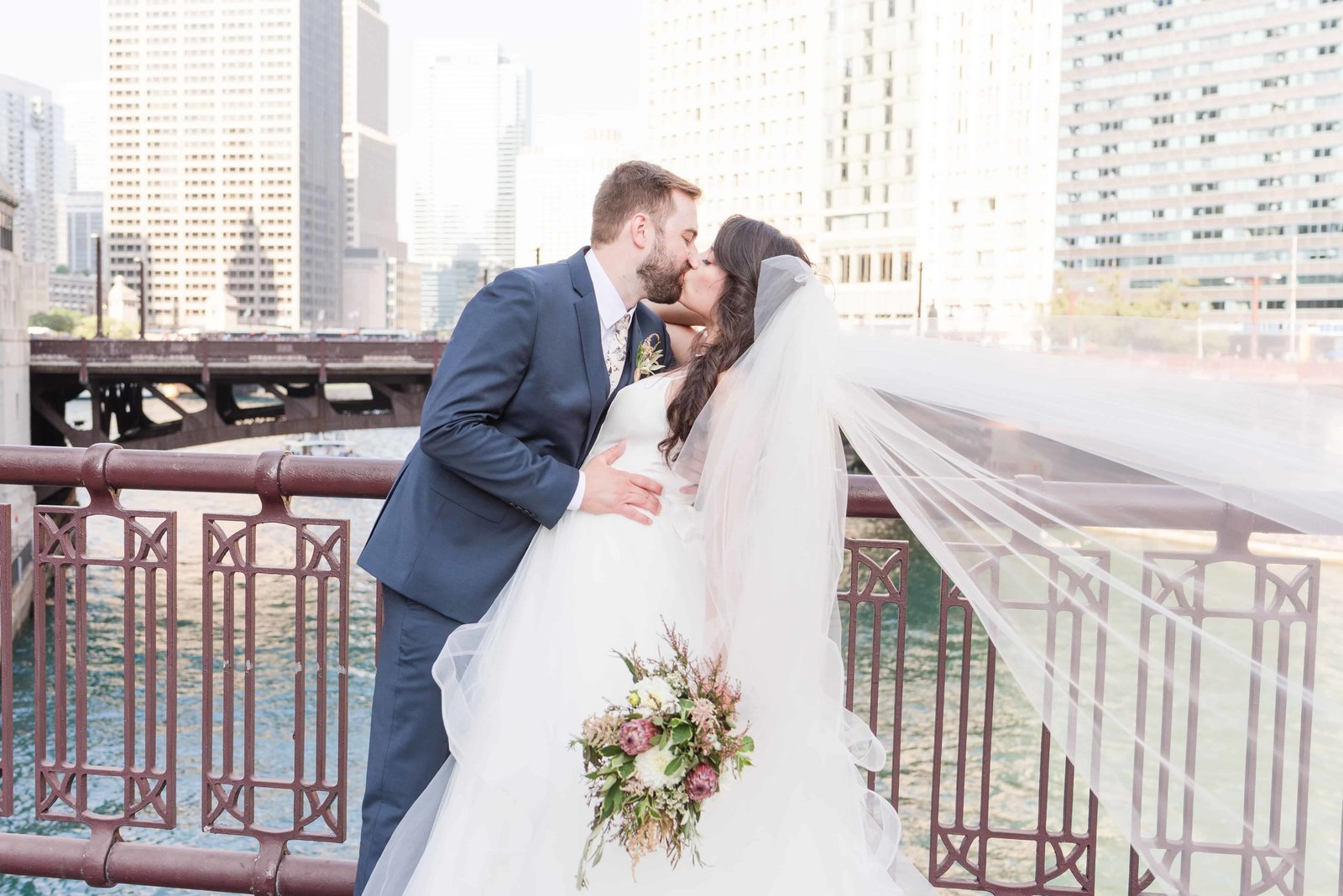 Couple kissing overlooking Chicago river in downtown Chicago